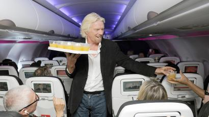 Richard Branson hands out orange juice.
