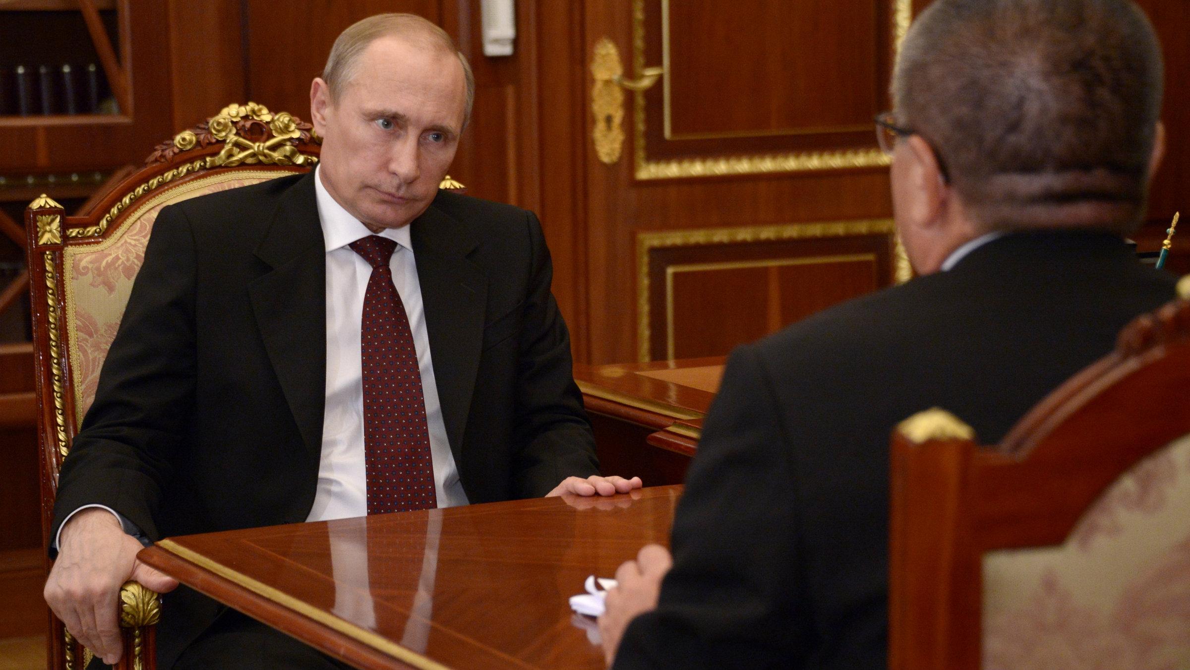 Russian President Vladimir Putin listens Russia's economic development minister Alexei Ulyukayev in Moscow's Kremlin.