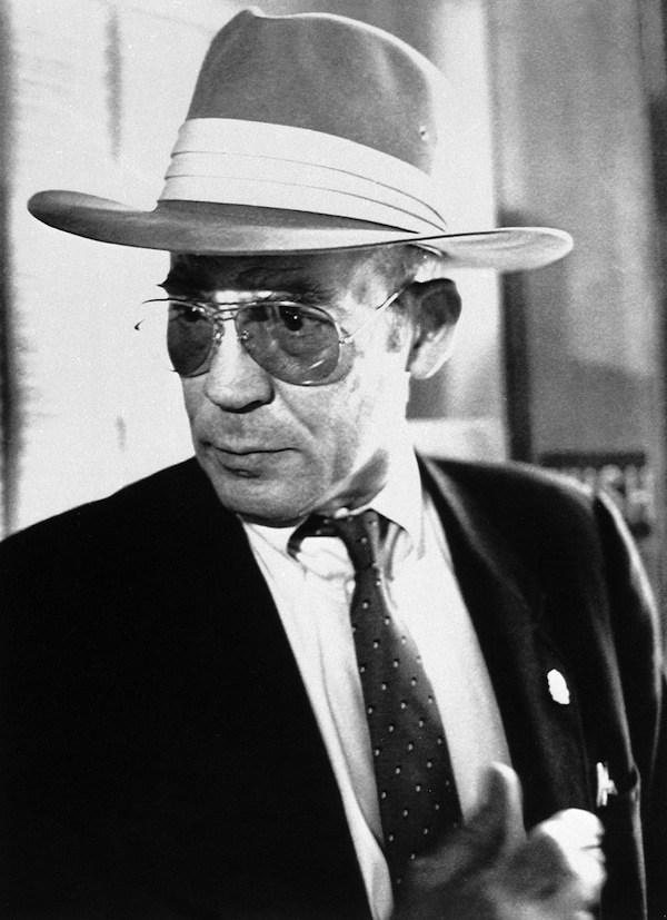 Author Hunter S. Thompson talks to reporters as he leaves a courtroom at the Pitkin County Courthouse in Aspen, Colo., Monday, April 10, 1990. (AP Photo/Frank Martin)
