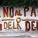 "A woman walks past a graffiti that reads ""No to the debt payment"" in Buenos Aires, July 28, 2014. Time is running out for Argentina to pay ""holdout"" investors suing Latin America's No. 3 economy for full payment on their bonds, or reach a deal that buys more time to avert a default."