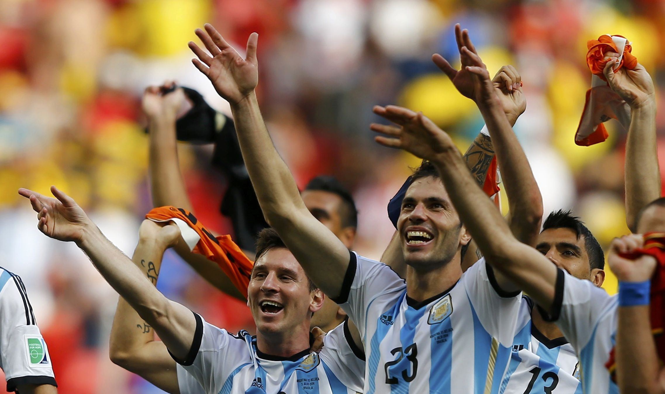 Argentina's Lionel Messi and teammates celebrate winning the 2014 World Cup quarter-finals between Argentina and Belgium at the Brasilia national stadium in Brasilia July 5, 2014. REUTERS/Dominic Ebenbichler (BRAZIL - Tags: TPX IMAGES OF THE DAY SOCCER SPORT WORLD CUP) TOPCUP