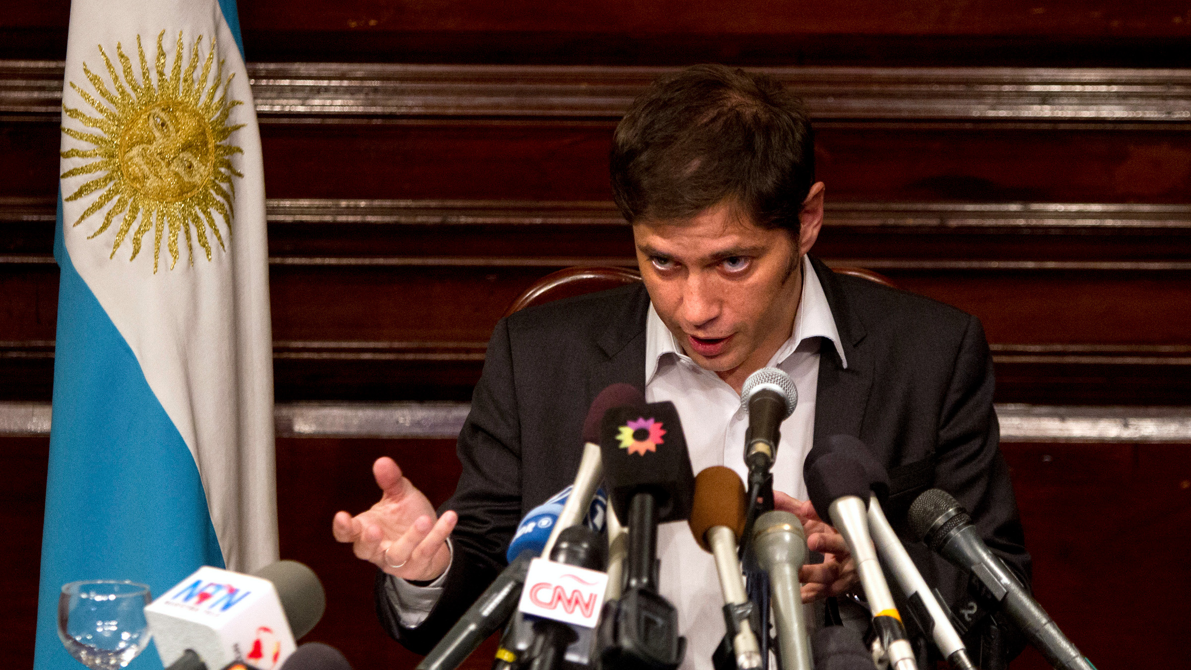 Argentina's Economy Minister Axel Kicillof speaks to the media at a press conference at the Argentine Consulate in New York July 30, 2014. Kicillof on Wednesday said the country offered a group of holdout creditors the same reduced payment terms it has agreed to pay other holders of its restructured bonds, but the holdouts refused the offer. The holdouts, a group of hedge funds that bought the bonds at a steep discount following Argentina's default on $100 billion of debt in 2002, also refused to ask a U.S. court to stay an order the blocks Argentina from paying its other creditors, Kicillof said.