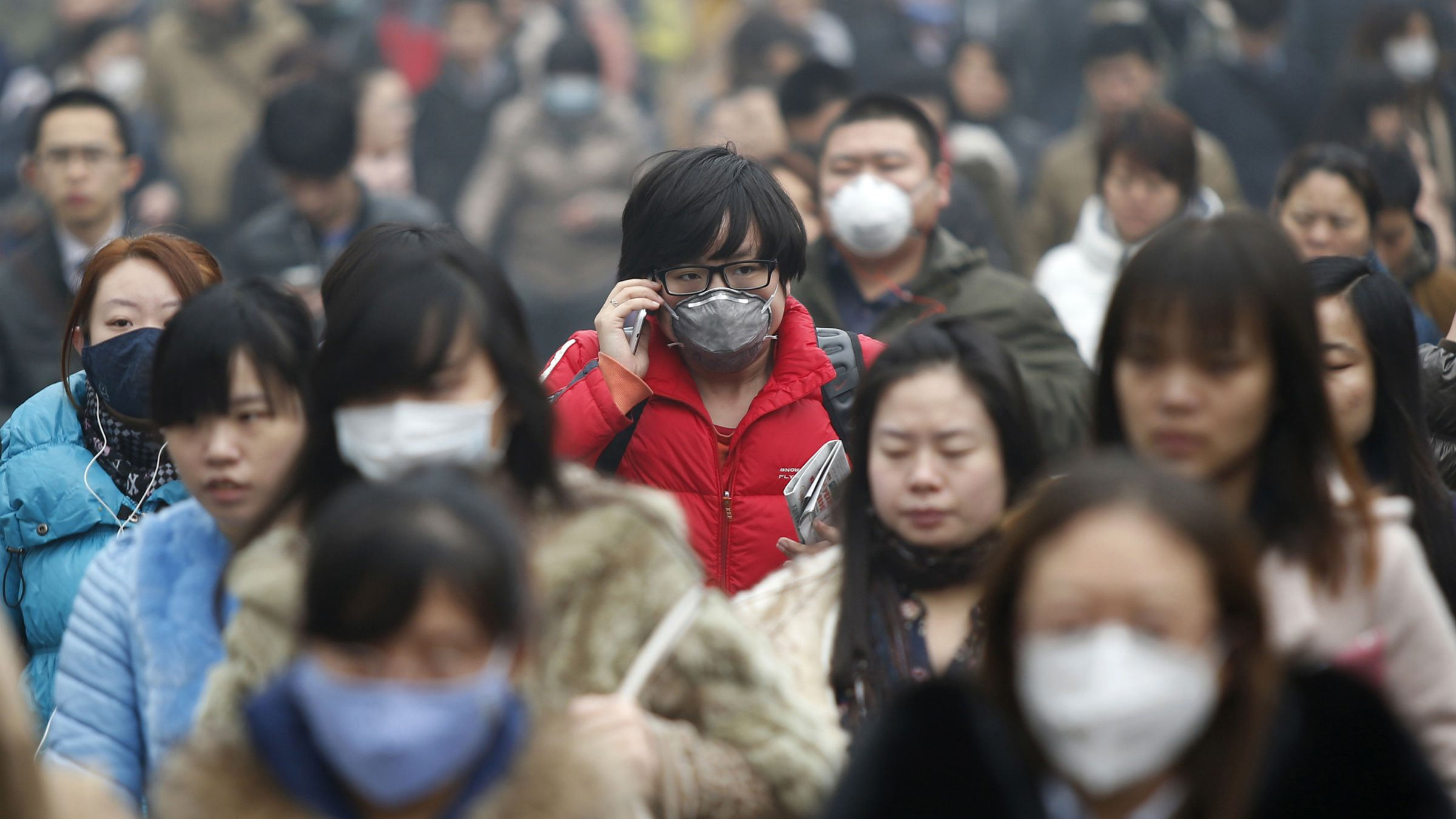 Commuters wearing masks make their way amid thick haze in the morning in Beijing February 26, 2014. China's north is suffering a pollution crisis, with the capital Beijing itself shrouded in acrid smog. Authorities have introduced anti-pollution policies and often pledged to clean up the environment but the problem has not eased. REUTERS/Kim Kyung-Hoon ibm green horizon beijing government big data