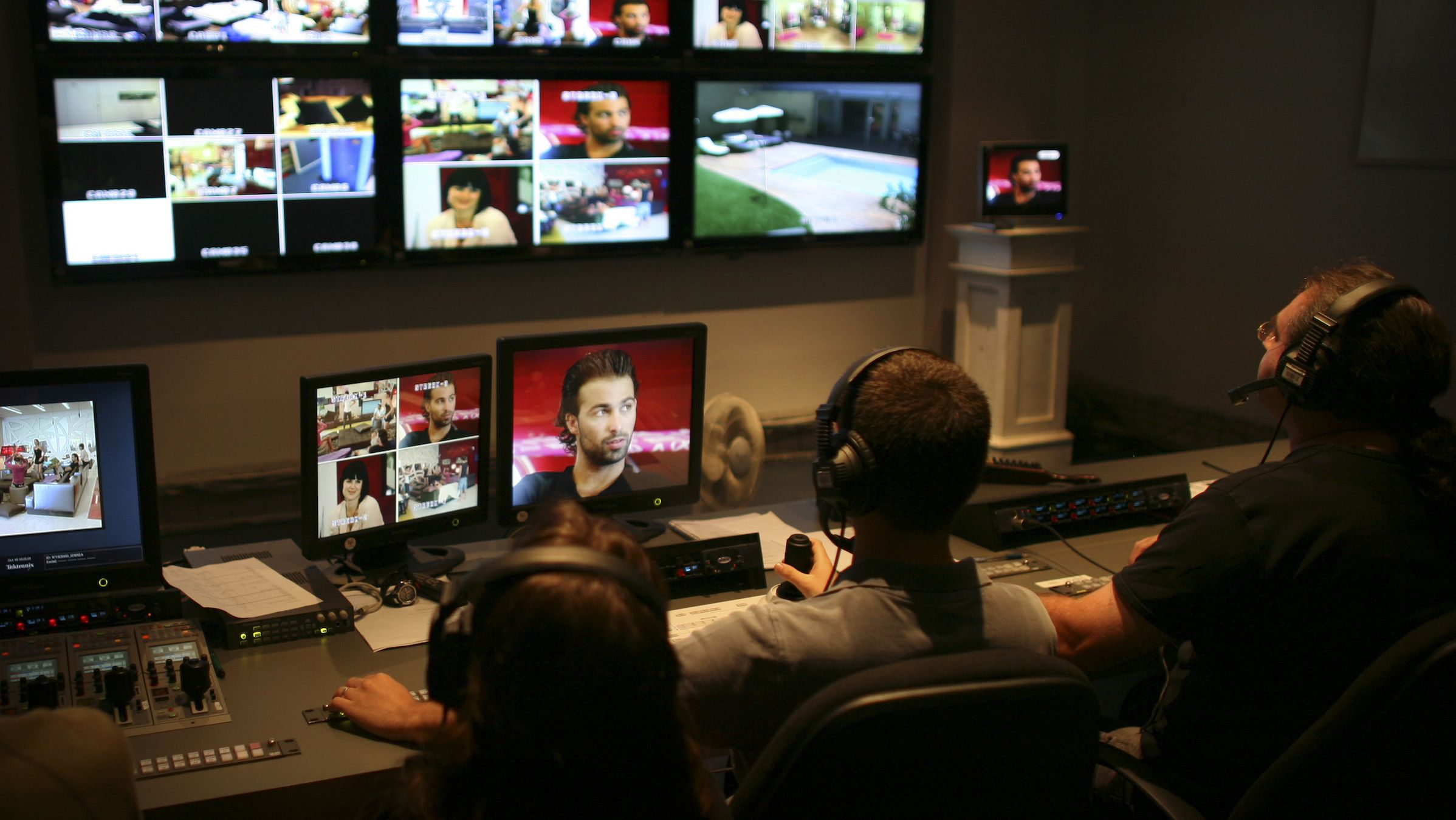 Israeli television editors and engineers work in the control room of the Israeli version of the reality television show Big Brother, in Neve Ilan, near Jerusalem, Sunday, Oct. 5, 2008. In Israel, even Big Brother has to take a break on the most solemn day of the Jewish calendar. When Israel marks Yom Kippur this week, the country will come to a complete standstill. For the makers of cult reality show Big Brother, this means turning off the cameras on the round-the-clock program and building a makeshift synagogue for a religious contestant. (AP Photo/Dan Balilty)