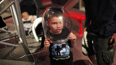 Boy in astronaut helmet