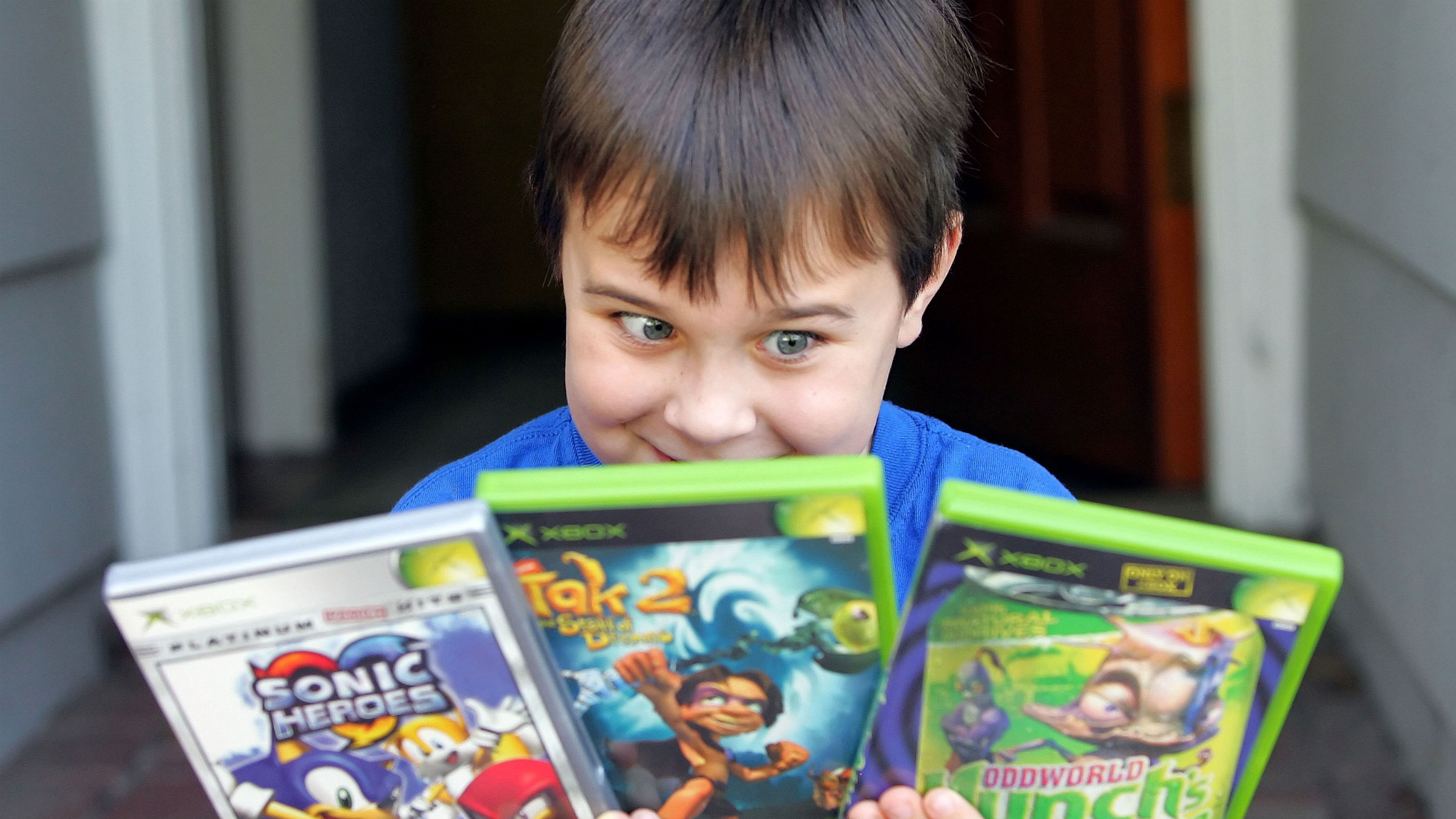 Boy with video games in his hands