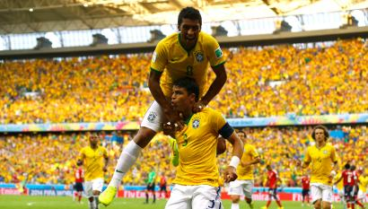 Brazil's Thiago Silva (3) celebrates with Paulinho after scoring a goal during the 2014 World Cup quarter-finals between Brazil and Colombia at the Castelao arena in Fortaleza July 4, 2014. REUTERS/Marcelo Del Pozo (BRAZIL - Tags: SOCCER SPORT WORLD CUP) - RTR3X636