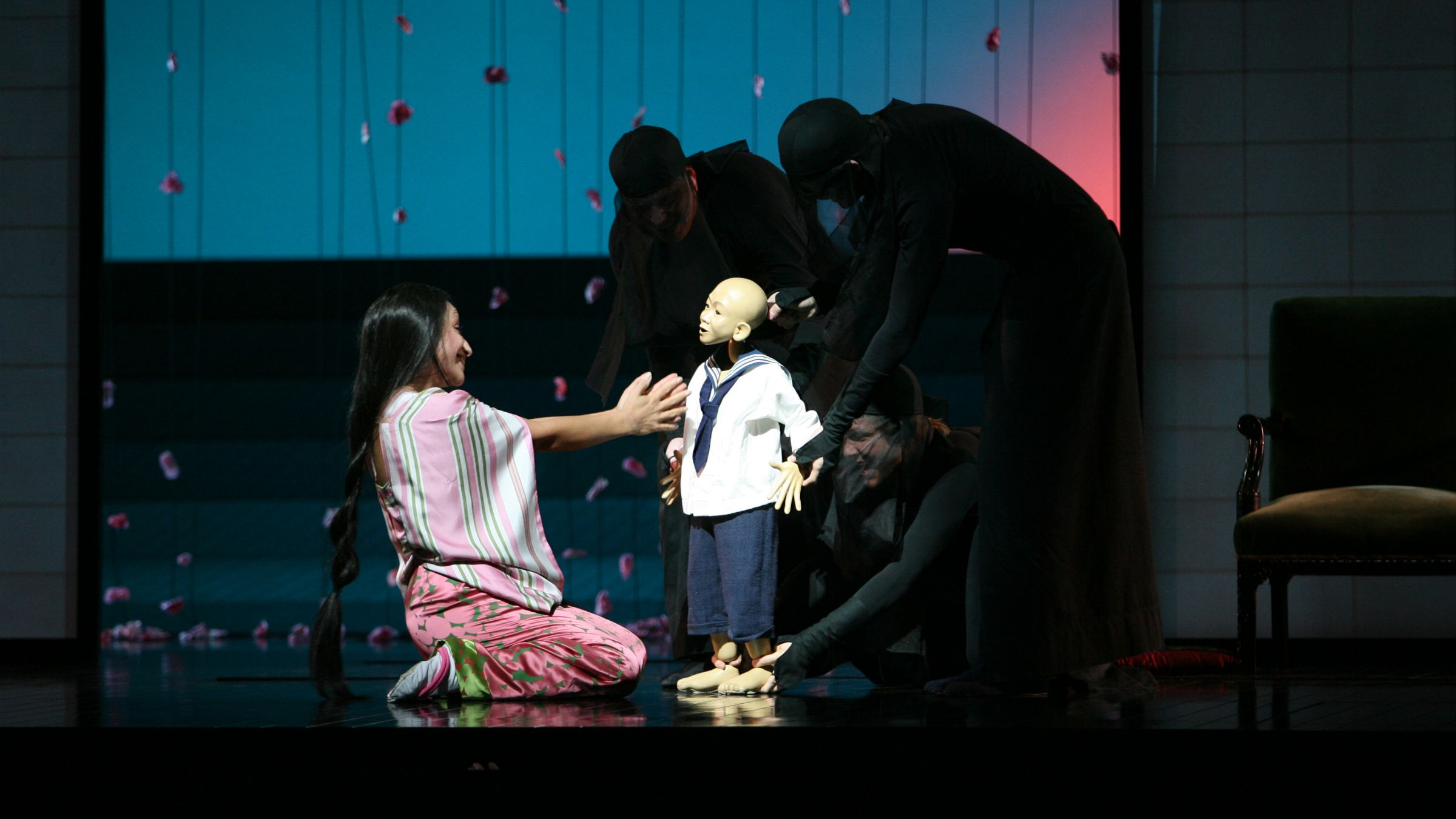 "Cristina Gallardo-Domas, left, performs the title roll, Cio-Cio-San, alongside puppeteers perfoming as Cio-Cio-San's child in the final dress rehearsal of Giacomo Puccini's ""Madama Butterfly"" or ""Madame Butterfly"" at the Metropolitan Opera, Friday, Sept. 22, 2006 in New York. (AP Photo/Mary Altaffer"