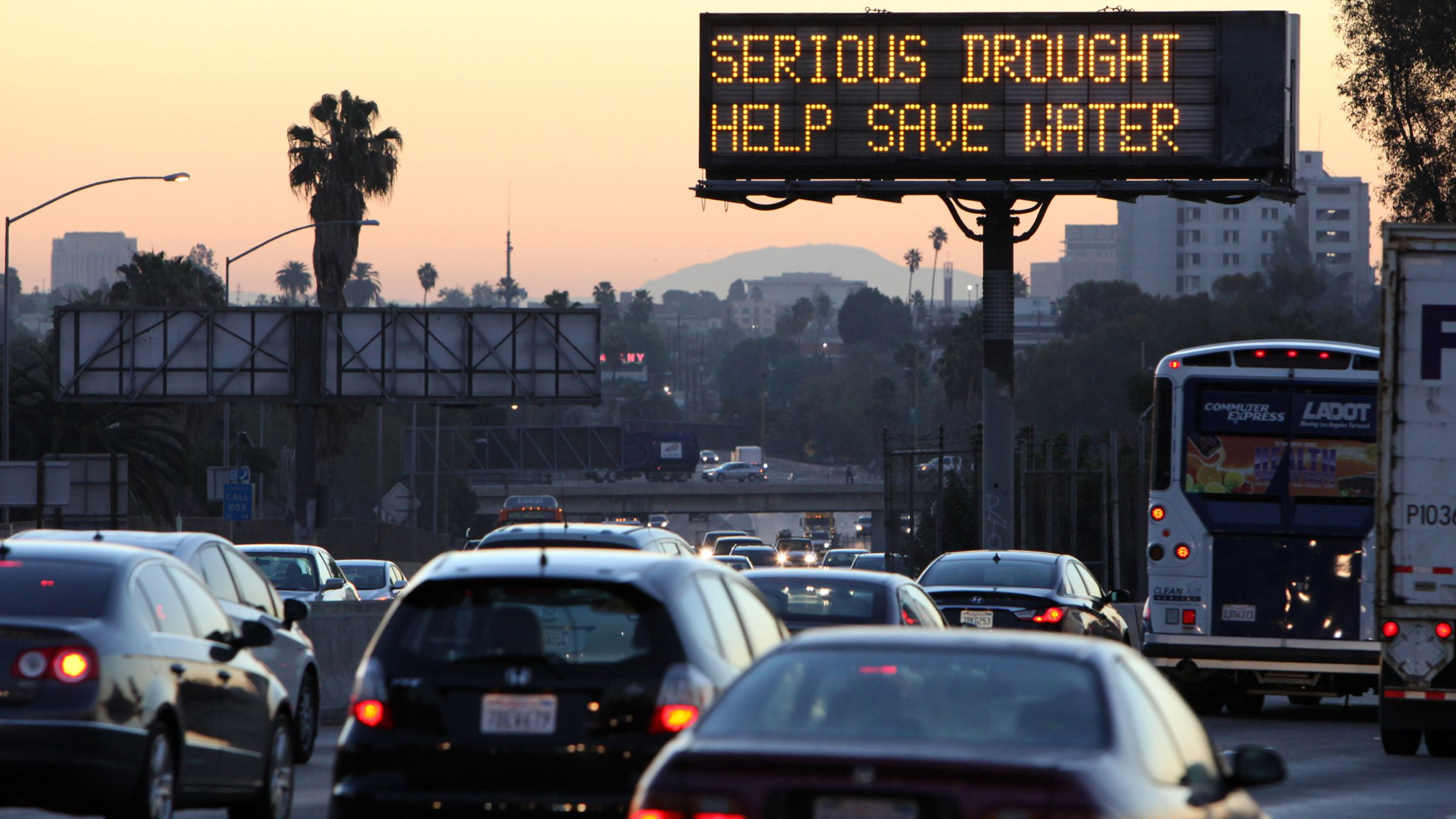 climate change colorado basin river drought In this Friday, Feb. 14, 2014, file photo, morning traffic makes it's way toward downtown Los Angeles along the Hollywood Freeway past an electronic sign warning of severe drought. Los Angeles has concluded another rain season with little to show for it. The National Weather Service says just 6.08 inches of rain was recorded downtown between July 1, 2013, and June 30. That's less than half the normal average of 14.93 inches and enters the books as the seventh-driest rain season since record-keeping began downtown in 1877. The previous rain season was worse, just 5.85 inches. (AP Photo/Richard Voge