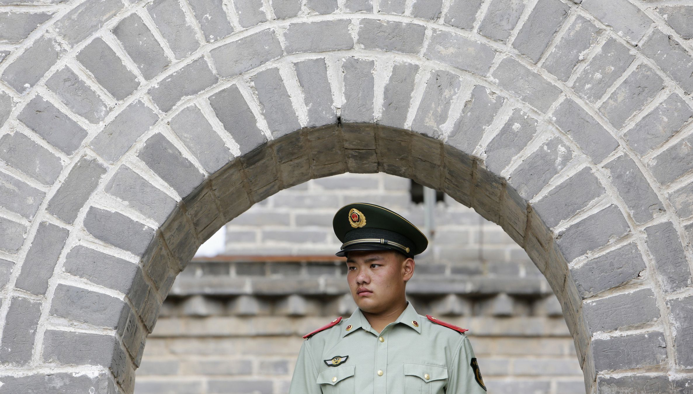 A paramilitary police officer stands guard before U.S. Secretary of State John Kerry and U.S. Treasury Secretary Jacob Lew arrive to tour the Badaling section of the Great Wall, on the outskirts of Beijing, July 8, 2014. The United States will press China to resume cooperation on fighting cyber espionage to ensure an orderly cyber environment, a senior U.S. official said on Tuesday ahead of annual talks between the world's two largest economies this week. REUTERS/Jason Lee (CHINA - Tags: POLITICS BUSINESS MILITARY) - RTR3XKRU
