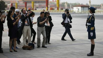 Journalists take photos in Tiananmen Square