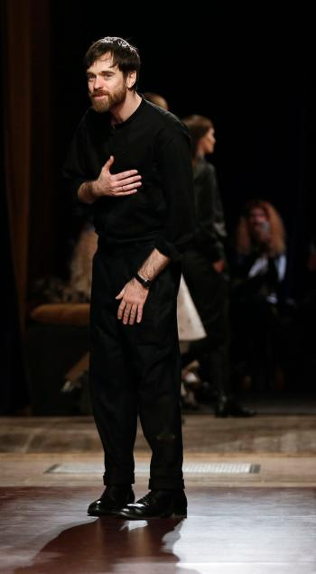 French designer Christophe Lemaire appears at the end of his Fall/Winter 2014-2015 women's ready-to-wear collection for fashion house Hermes during Paris Fashion Week March 5, 2014. REUTERS/Gonzalo Fuentes (FRANCE - Tags: FASHION) - RTR3G2QY