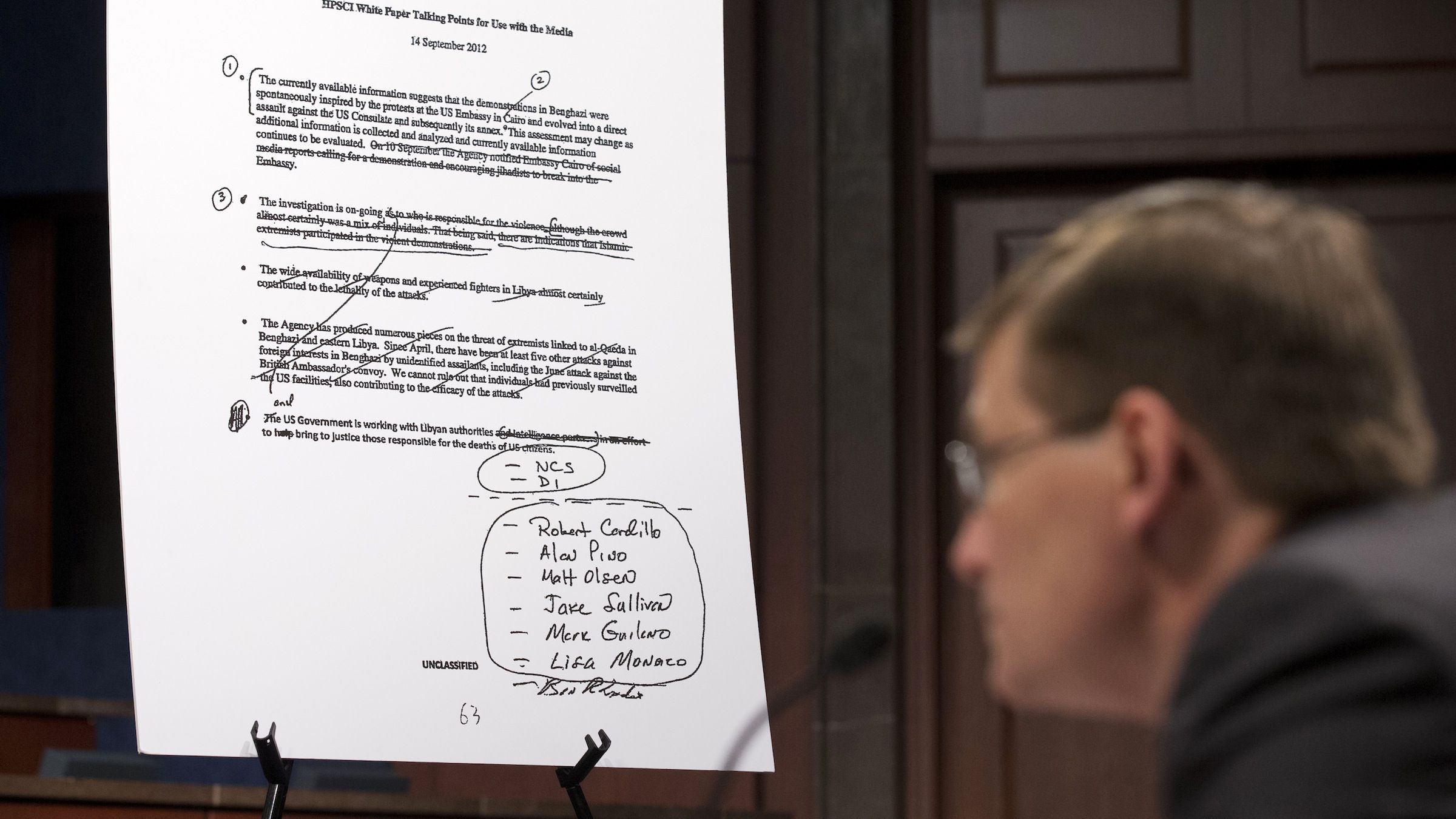 An unclassified talking points document is shown as former CIA Deputy Director Michael Morell testifies on Capitol Hill in Washington, Wednesday, April 2, 2014, before the House Intelligence Committee.  Morell, who edited the widely debunked talking points on the 2012 Benghazi attack, answered questions from the House intelligence committee in a rare open session. The hearing provides Morell with a chance to explain why he deleted references to al-Qaida.  (AP Photo/Manuel Balce Ceneta)