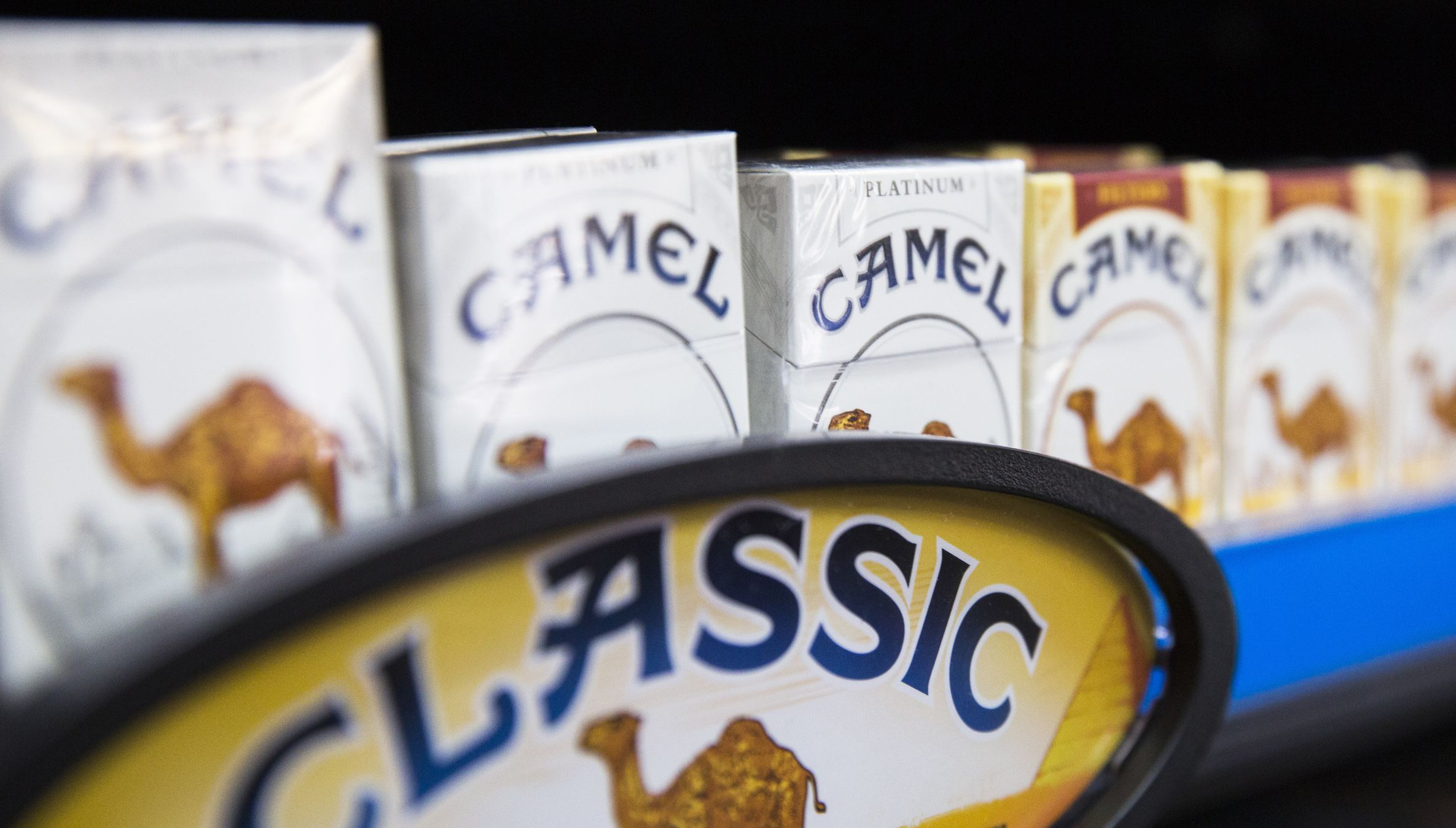 Camel cigarettes are stacked on a shelf inside a tobacco store in New York July 11, 2014. U.S. cigarette maker Reynolds American Inc is in talks to acquire rival Lorillard Inc in a multi-billion dollar deal that would reshape one of the world's biggest and most profitable tobacco markets, the companies said on Friday. In a statement confirming what people familiar with the matter previously told Reuters, Reynolds, No.2 player in the United States with brands including Camel and Pall Mall, said the talks were consistent with its strategy of weighing options that would help boost shareholder value. Buying Lorillard, which had a stock market value of $22.9 billion on Thursday, would give Reynolds the leading U.S. menthol cigarette Newport and its leading e-cigarette blu.Buying Lorillard, which had a stock market value of $22.9 billion on Thursday, would give Reynolds the leading U.S. menthol cigarette Newport and its leading e-cigarette blu. REUTERS/Lucas Jackson (UNITED STATES - Tags: BUSINESS) - RTR3Y7FF