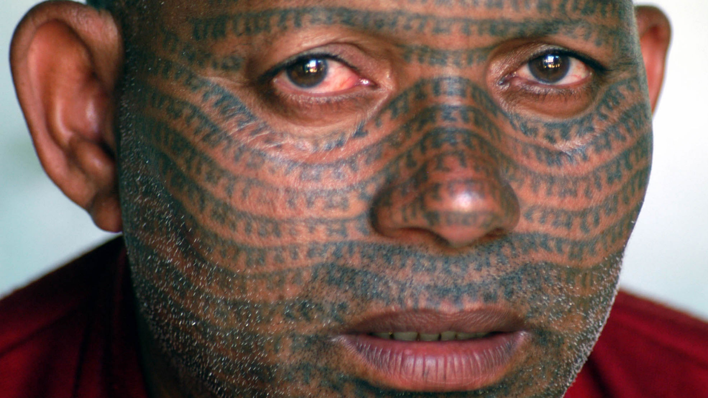 Firatram, 47, of the Ramnami Panth sect, looks on with tattooed face in village Khapradi, in the northern Indian state of Chhatisgarh, Wednesday, Sept. 22, 2004. This sect, consisting mainly of the lower castes, often have their bodies tattooed with the name of Hindu God Ram.