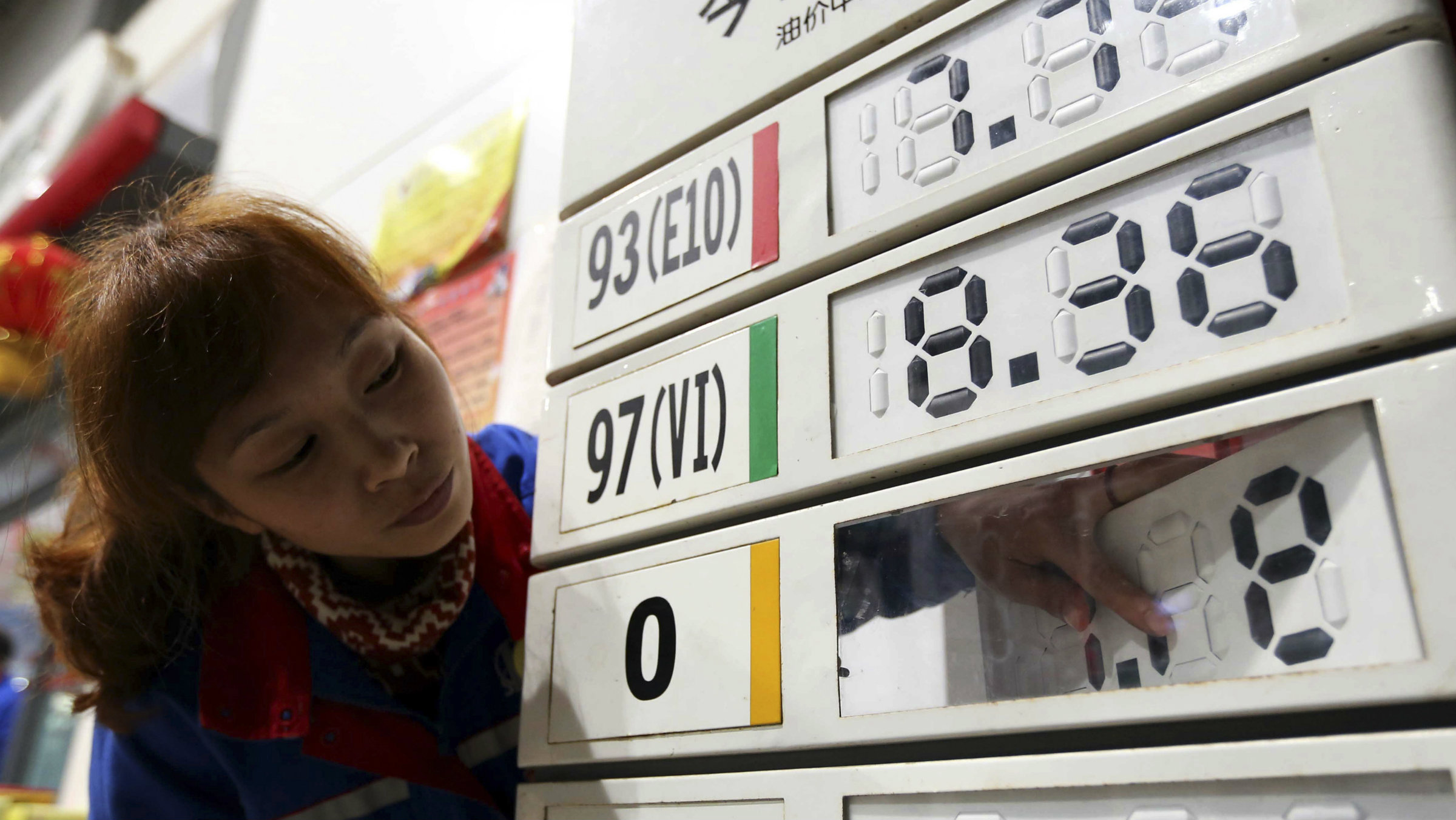 The diesel price is reduced at a gas station in Rongshui, China., in March 2014.