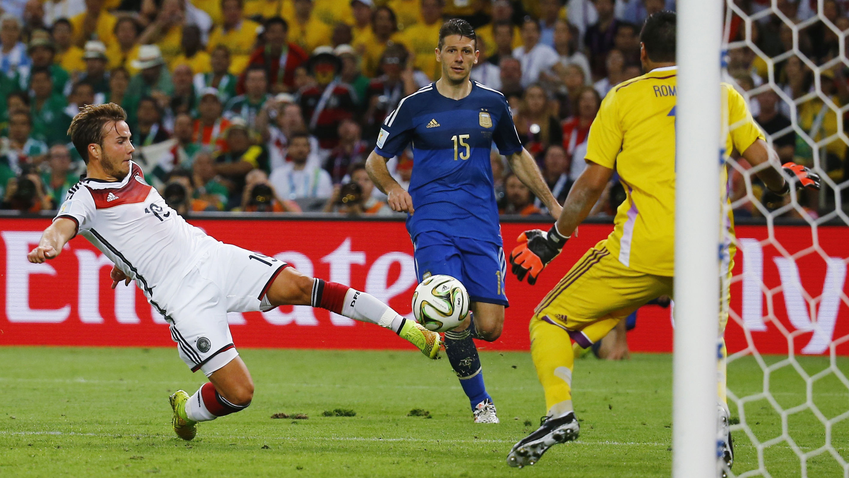Germany's Mario Goetze shoots to score a goal past Argentina's goalkeeper Sergio Romero during extra time in their 2014 World Cup final at the Maracana stadium in Rio de Janeiro July 13, 2014. REUTERS/Kai Pfaffenbach