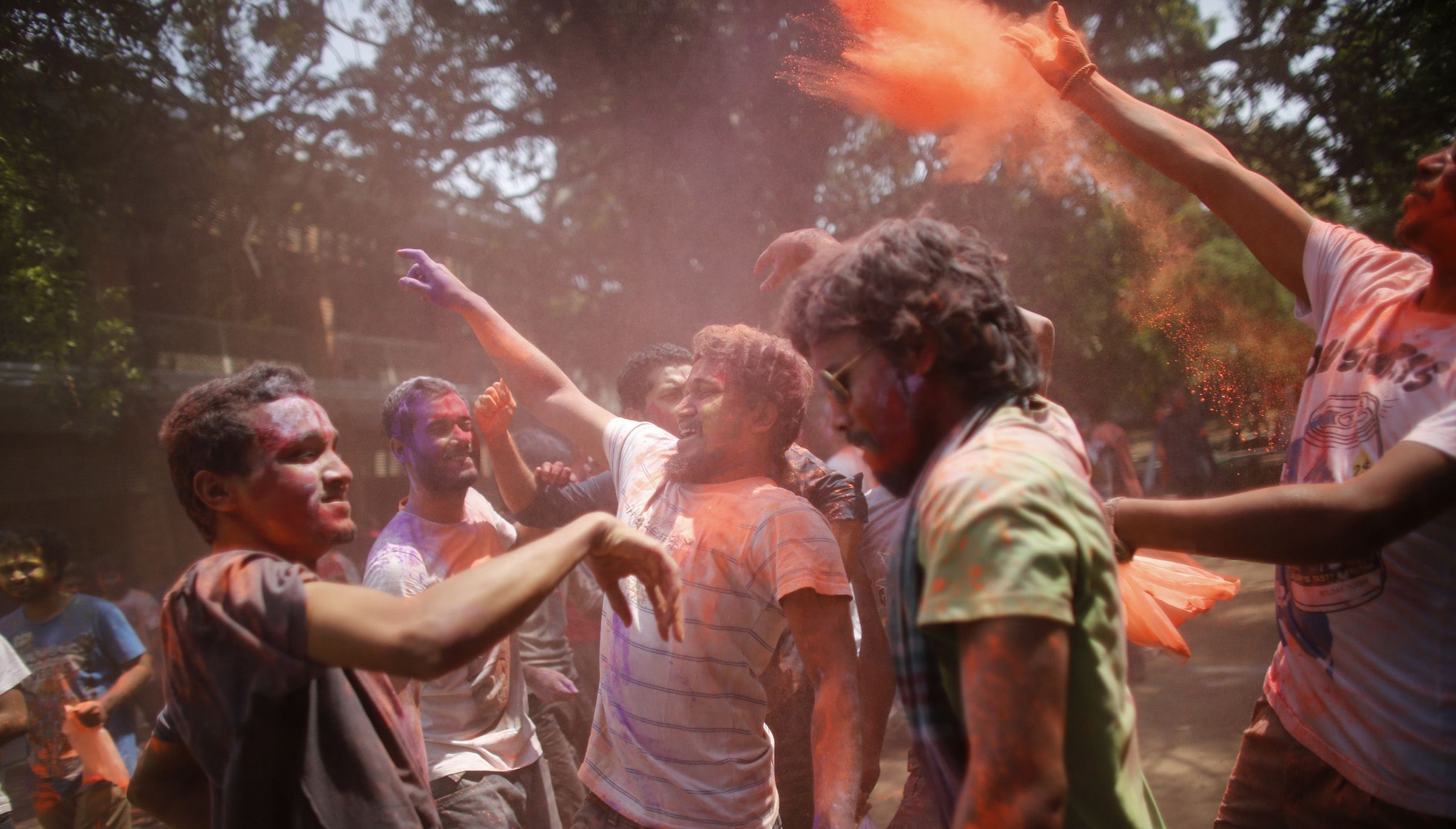 Students from the Fine Art Institute of the University of Dhaka dance as coloured powder is thrown at them during Holi celebrations in Dhaka March 28, 2013. Holi, also known as the Festival of Colours, heralds the beginning of spring and is celebrated by Hindu community in Bangladesh. REUTERS/Andrew Biraj (BANGLADESH - Tags: RELIGION SOCIETY) - RTXY0EO