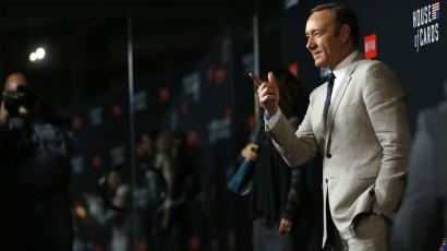 """Kevin Spacey poses at the premiere for the second season of the television series """"House of Cards"""" at the Directors Guild of America in Los Angeles, California February 13, 2014."""