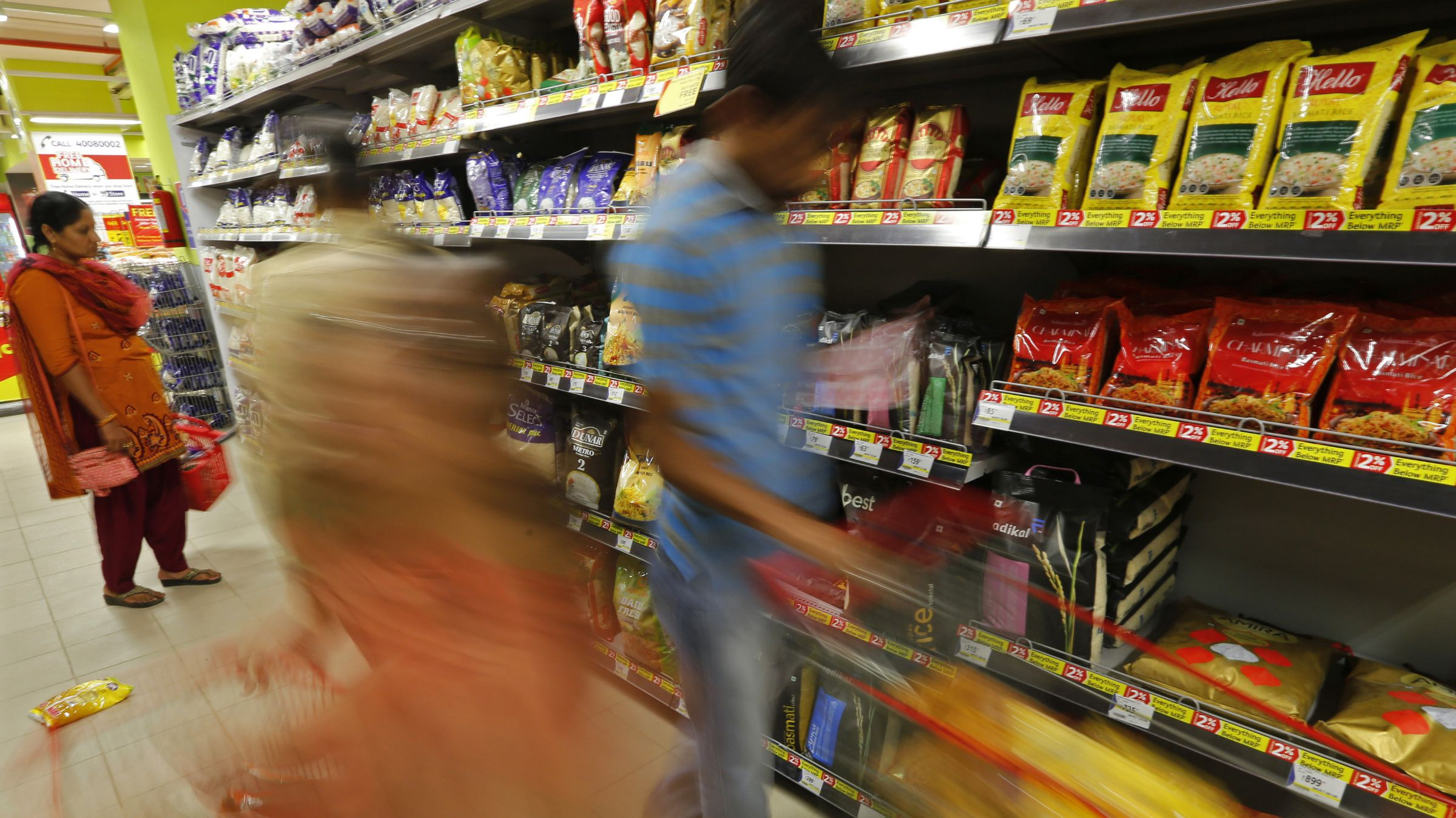 Customers shop inside a newly inaugurated Reliance Mart super store in the western Indian city of Ahmedabad May 24, 2014.