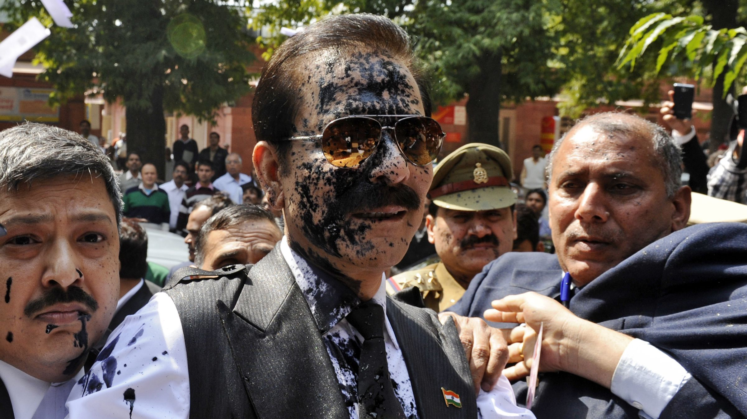 Subrata Roy with his face smeared in ink thrown by an unidentified man upon his arrival at the Supreme Court in New Delhi.