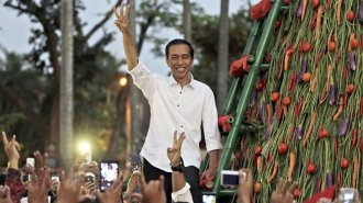 No indonesia is not proof that muslim democracy can work quartz indonesian president elect joko widodo greets supporters with his three finger greeting m4hsunfo