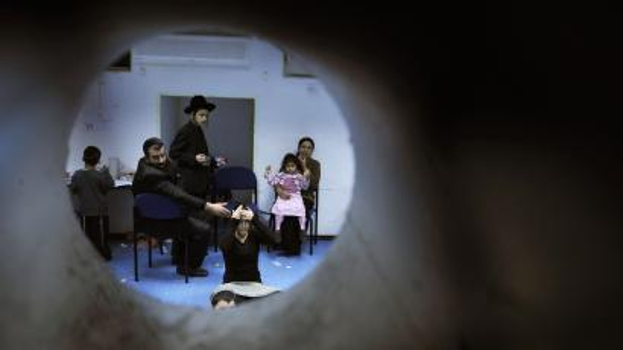 Israelis in bomb shelter