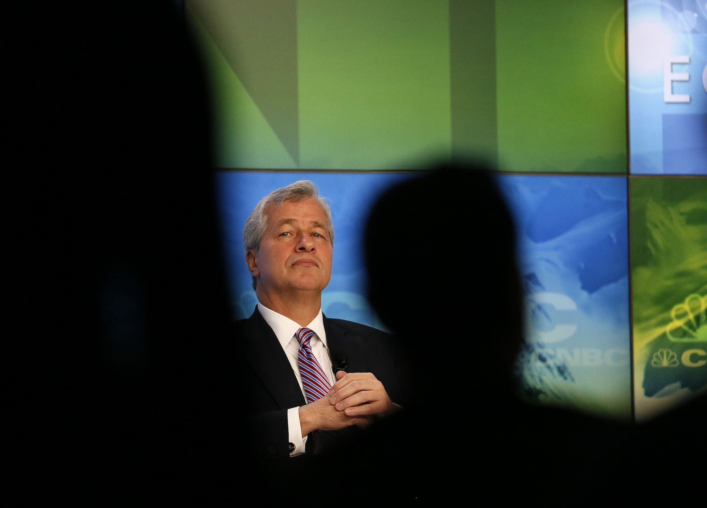 JP Morgan Chairman and Chief Executive Jamie Dimon is seen in between the audience as he attends a session during annual World Economic Forum meeting in Davos
