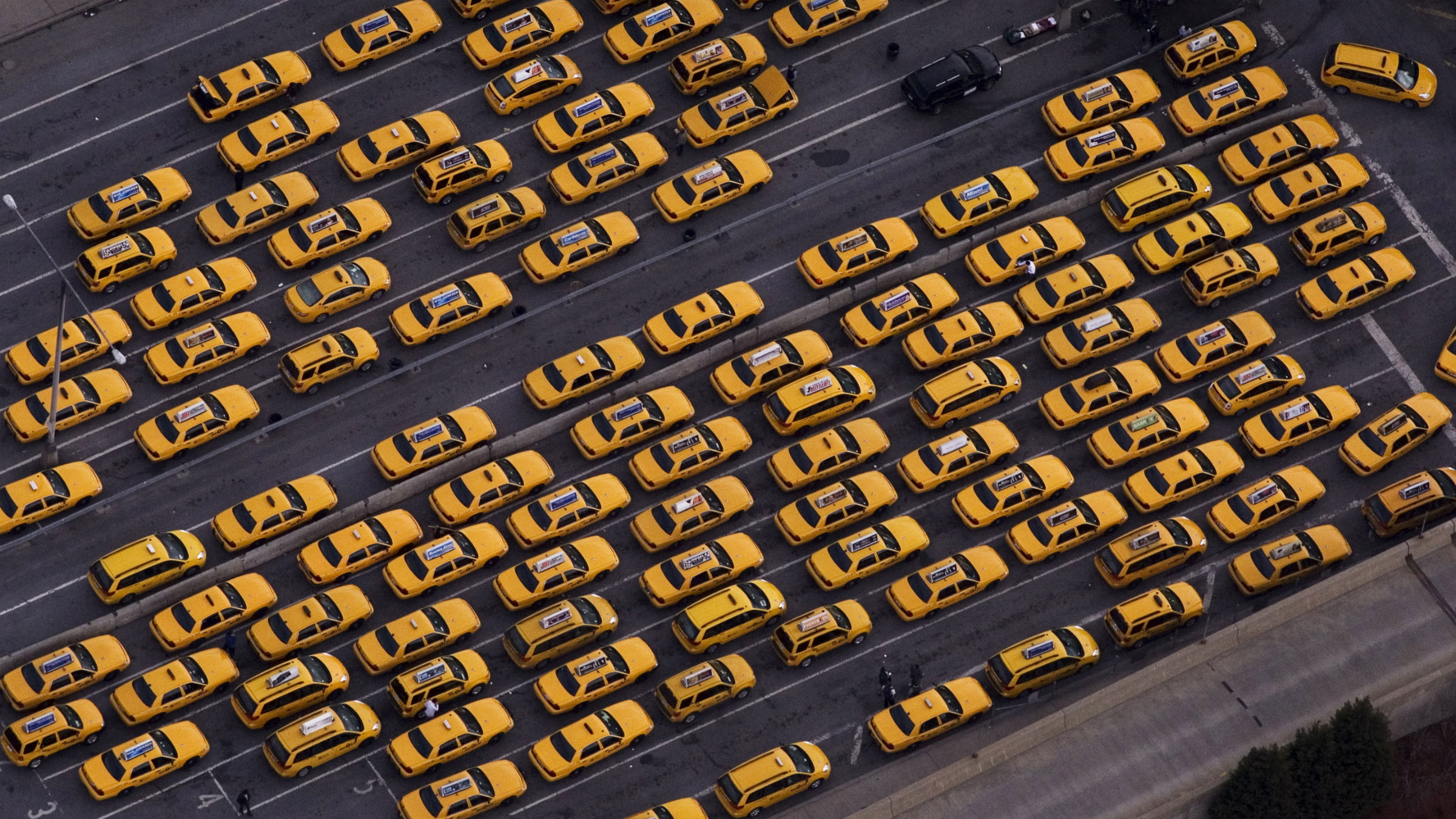 New York City taxis are lined up at a LaGuardia Airport dispatch area in this aerial photo Sunday, March 22, 2009 in New York.