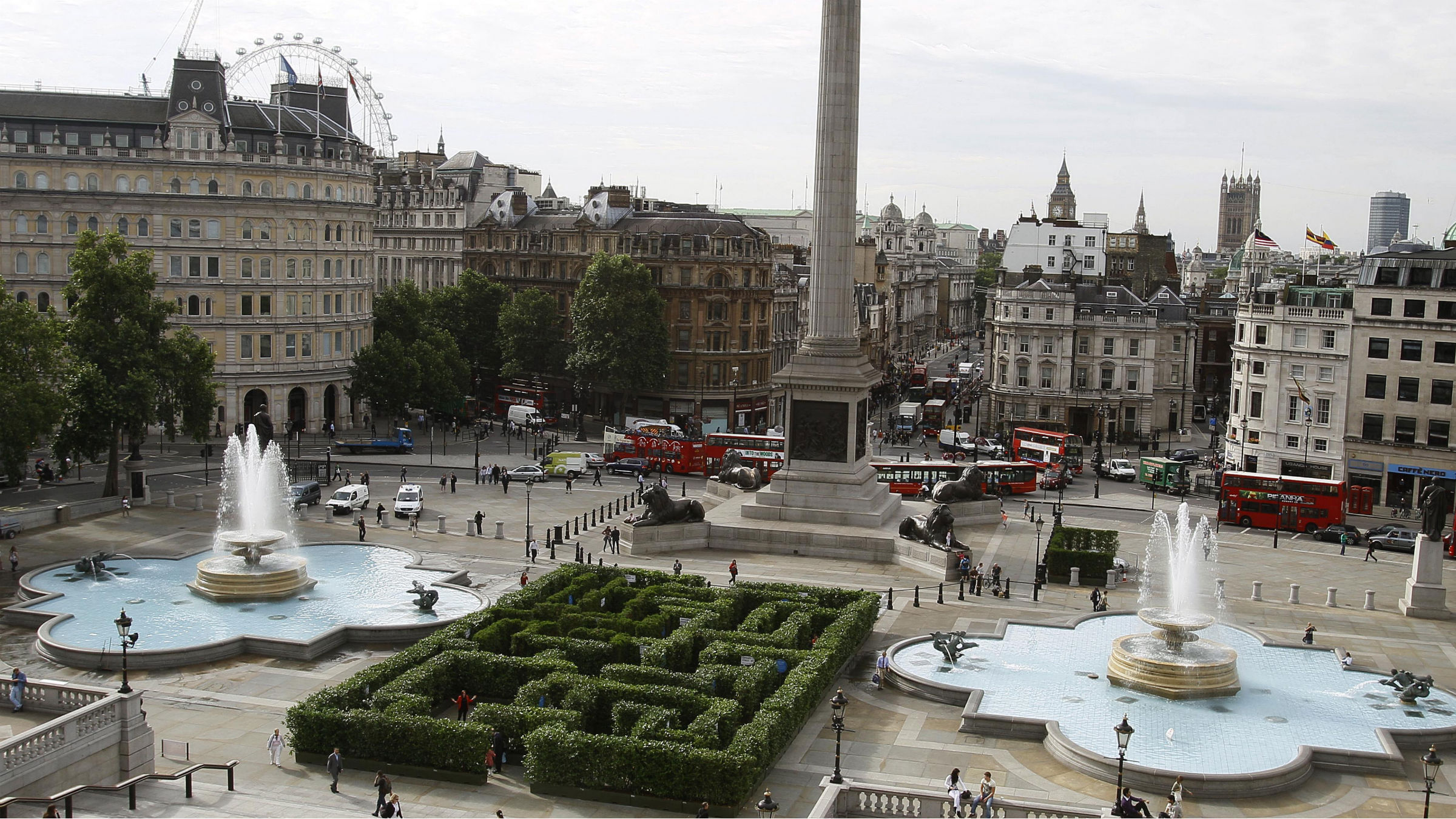 A maze is constructed in Trafalgar Square, between the fountains at the foot of Nelson's Column, in London, as part of a project by the West End Partnership to encourage visitors to explore hidden corners of the West End area of London, Monday, Aug. 2, 2010. The hedge maze is open to all visitors to explore and a program of cultural activities are planned to entertain those who venture into the labyrinth. Big Bens clock tower and part of Houses of Parliament seen on horizon centre right, and London Eye wheel back left.