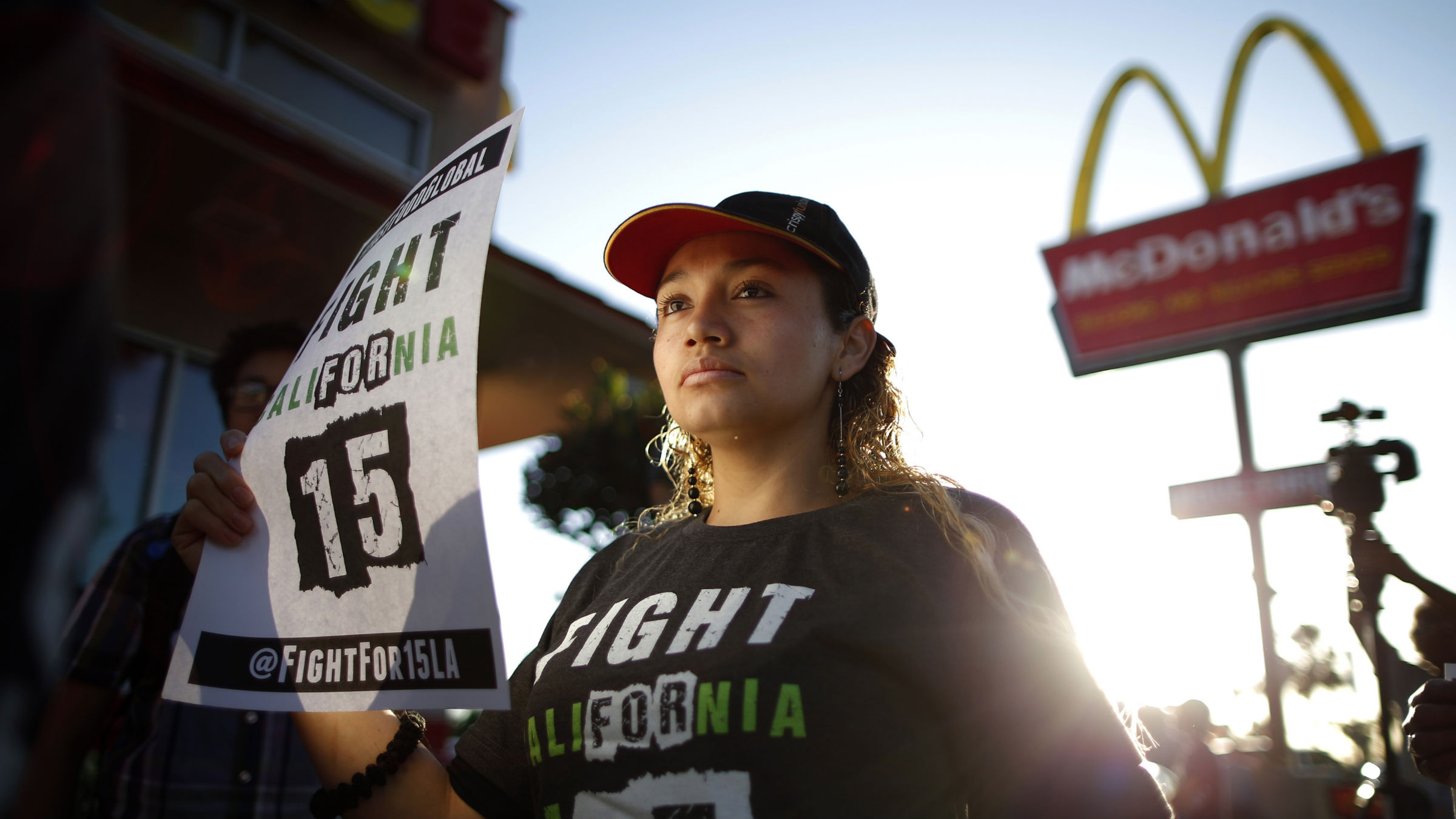 Demonstrators take part in a protest to demand higher wages for fast-food workers outside McDonald's in Los Angeles, California May 15, 2014. The march was held as part of an international protest by fast-food workers who planned to go on strikes in 150 cities across the United States and demonstrations in 33 other countries on Thursday to demand higher pay and better working conditions.