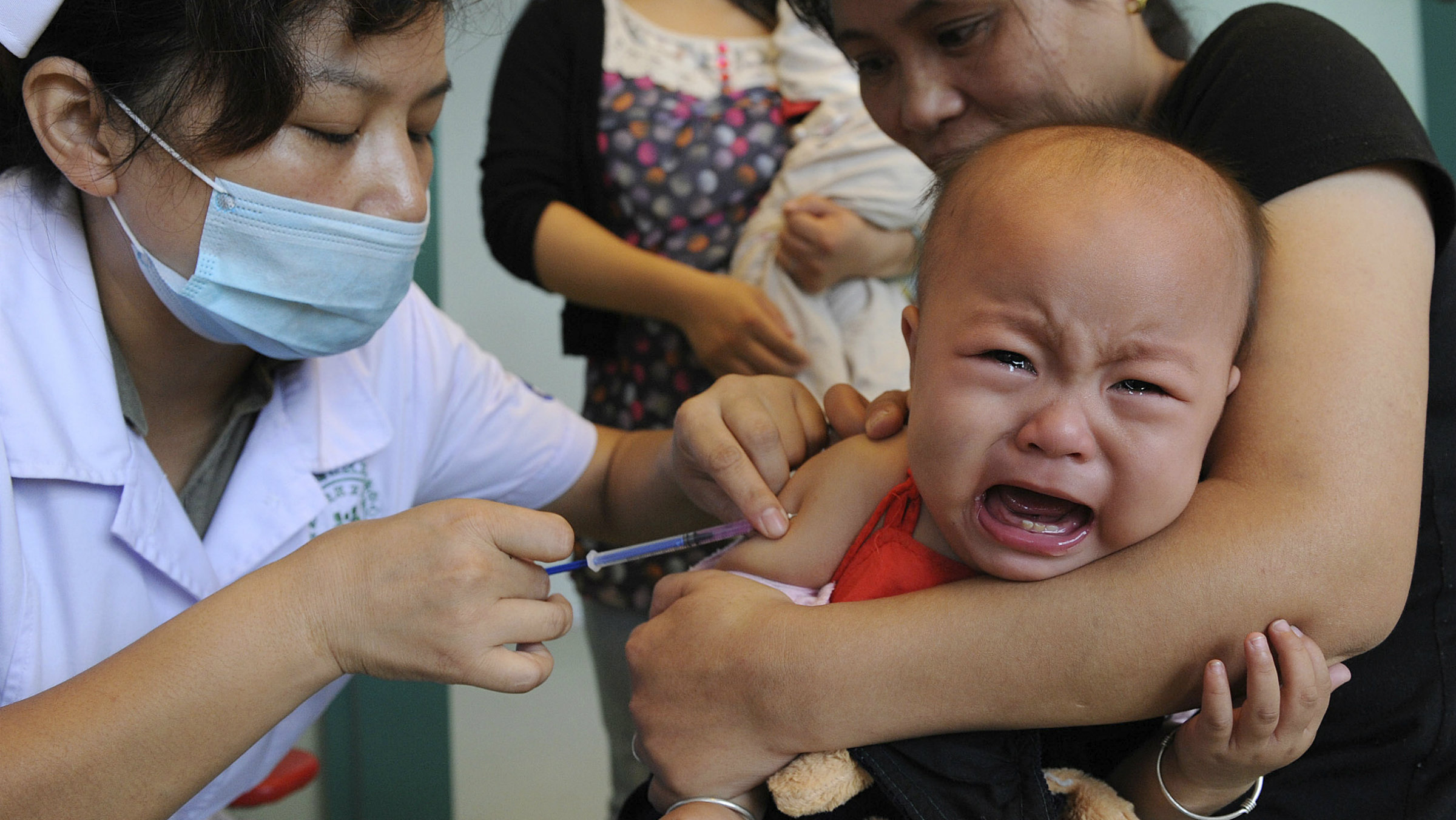 A nurse vaccinates a baby against measles in Hefei, Anhui province.