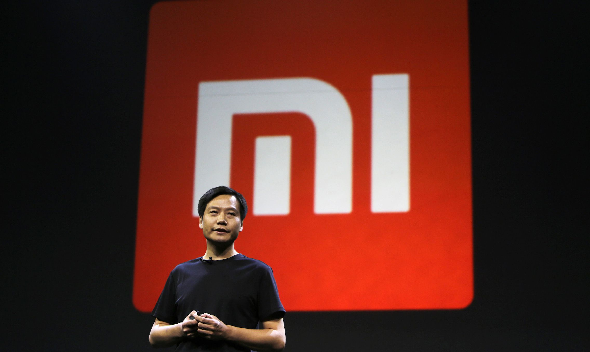 Lei Jun, founder and CEO of China's mobile company Xiaomi, speaks at a launch ceremony of Xiaomi Phone 4, in Beijing, July 22, 2014. China's Xiaomi unveiled on Tuesday its new flagship Mi 4 smartphone, aimed squarely at the premium handset market dominated by Apple Inc and Samsung Electronics Co Ltd. REUTERS/Jason Lee (CHINA - Tags: BUSINESS TELECOMS SCIENCE TECHNOLOGY LOGO) - RTR3ZN52