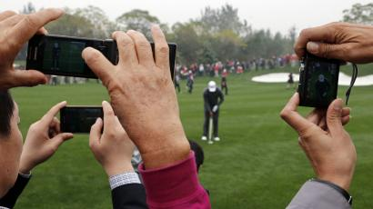 People taking pictures of golf in China