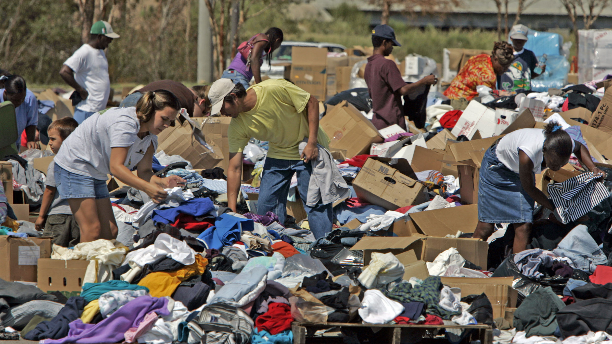 Residents search for clothes in a donation area in Gulfport, Miss., on Thursday, Sept. 8, 2005. Aid is pouring in from across the country and volunteers from various agencies continue to arrive to help victims of Hurricane Katrina.