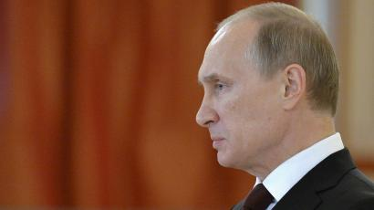 Russia president Vladimir Putin welcomes diplomats at a reception in Moscow.