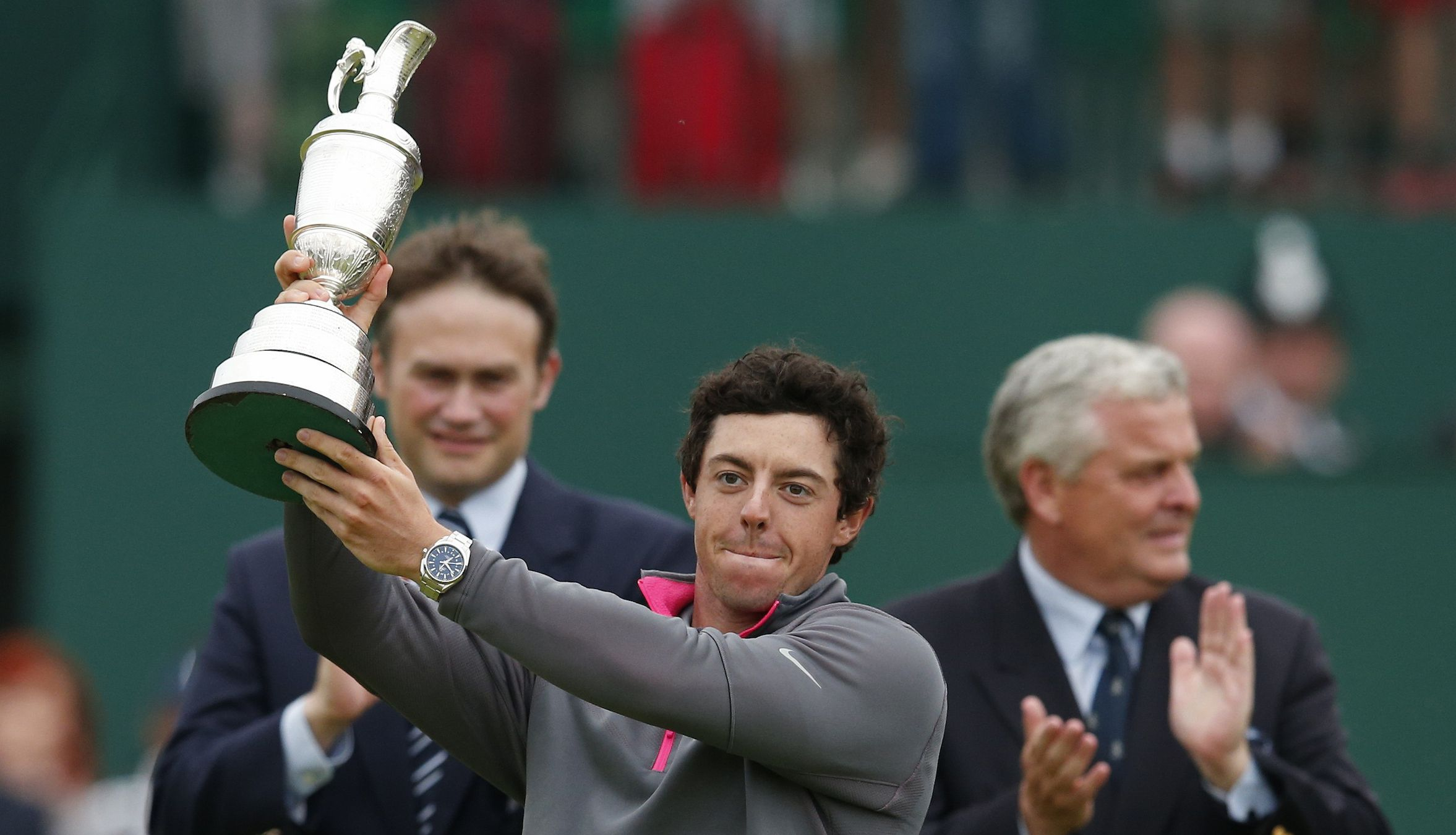 Rory McIlroy of Northern Ireland celebrates as he holds the Claret Jug after winning the British Open Championship at the Royal Liverpool Golf Club in Hoylake, northern England July 20, 2014. REUTERS/Cathal McNaughton (BRITAIN  - Tags: SPORT GOLF)   - RTR3ZFLZ