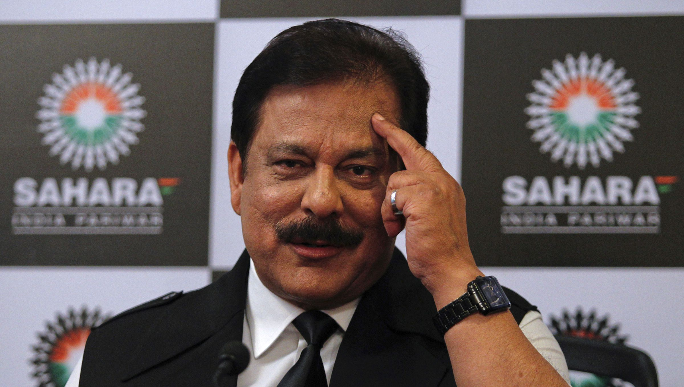Sahara Group Chairman Subrata Roy gestures as he speaks during a news conference in Mumbai February 4, 2012. Sahara Group has pulled out of its sponsorship deal with the Indian cricket board and the Pune franchise of the Indian Premier League (IPL), the diversified business conglomerate said on Saturday. REUTERS/Danish Siddiqui (INDIA - Tags: SPORT BUSINESS CRICKET HEADSHOT) - RTR2XAHZ