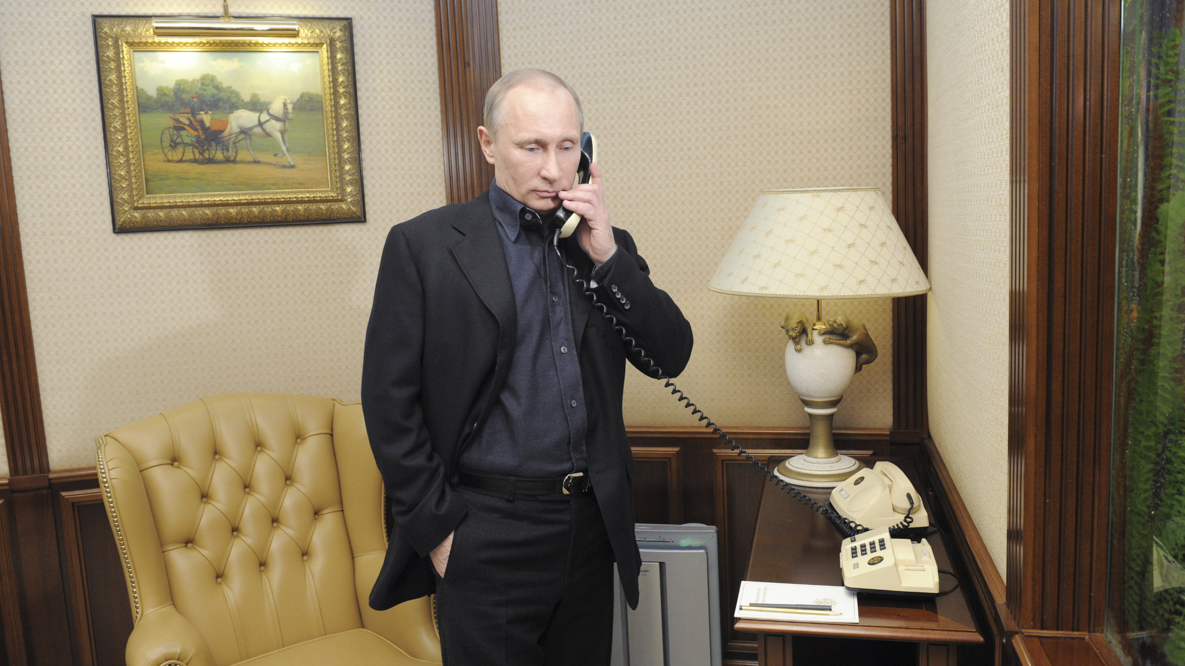 Vladimir Putin speaks on the phone at his campaign headquarters in Moscow.