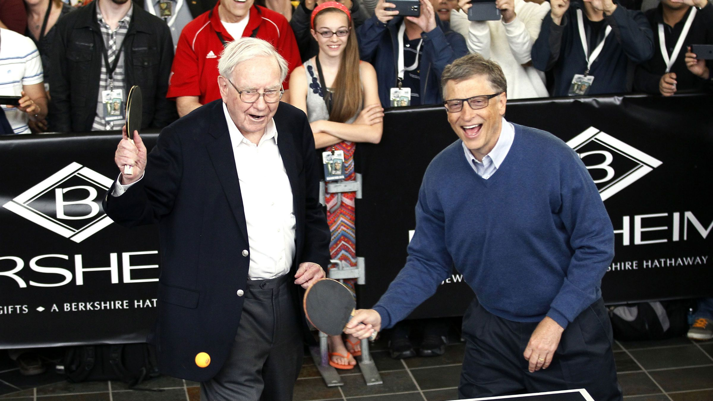 """Berkshire Hathaway CEO Warren Buffett (L) and friend Bill Gates, founder of Microsoft, play table tennis at a Berkshire sponsored reception in Omaha, Nebraska May 4, 2014 as part of the company annual meeting weekend. The investment guru was peppered with questions at the meeting, part of a mostly festive weekend that Buffett calls """"Woodstock for Capitalists,"""" following concerns that Berkshire last year missed Buffett's five-year growth target for the first time in his 49 years at the helm."""