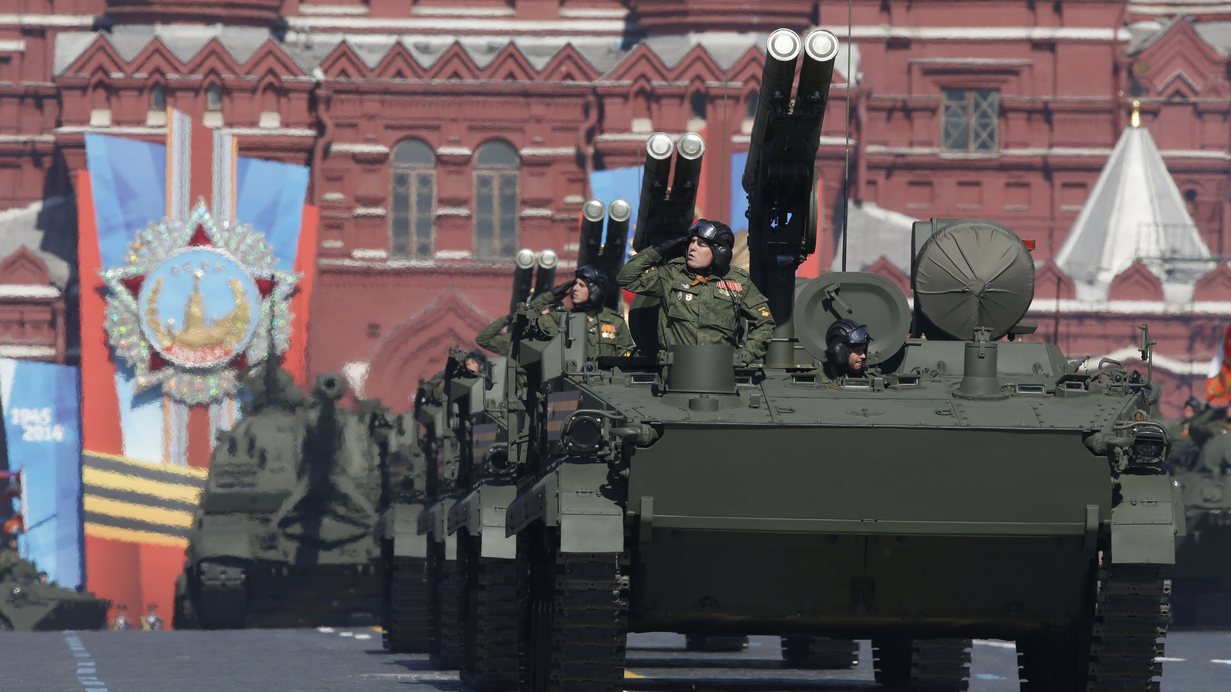 Russian servicemen aboard armoured military vehicles salute during the Victory Day parade in Moscow's Red Square.