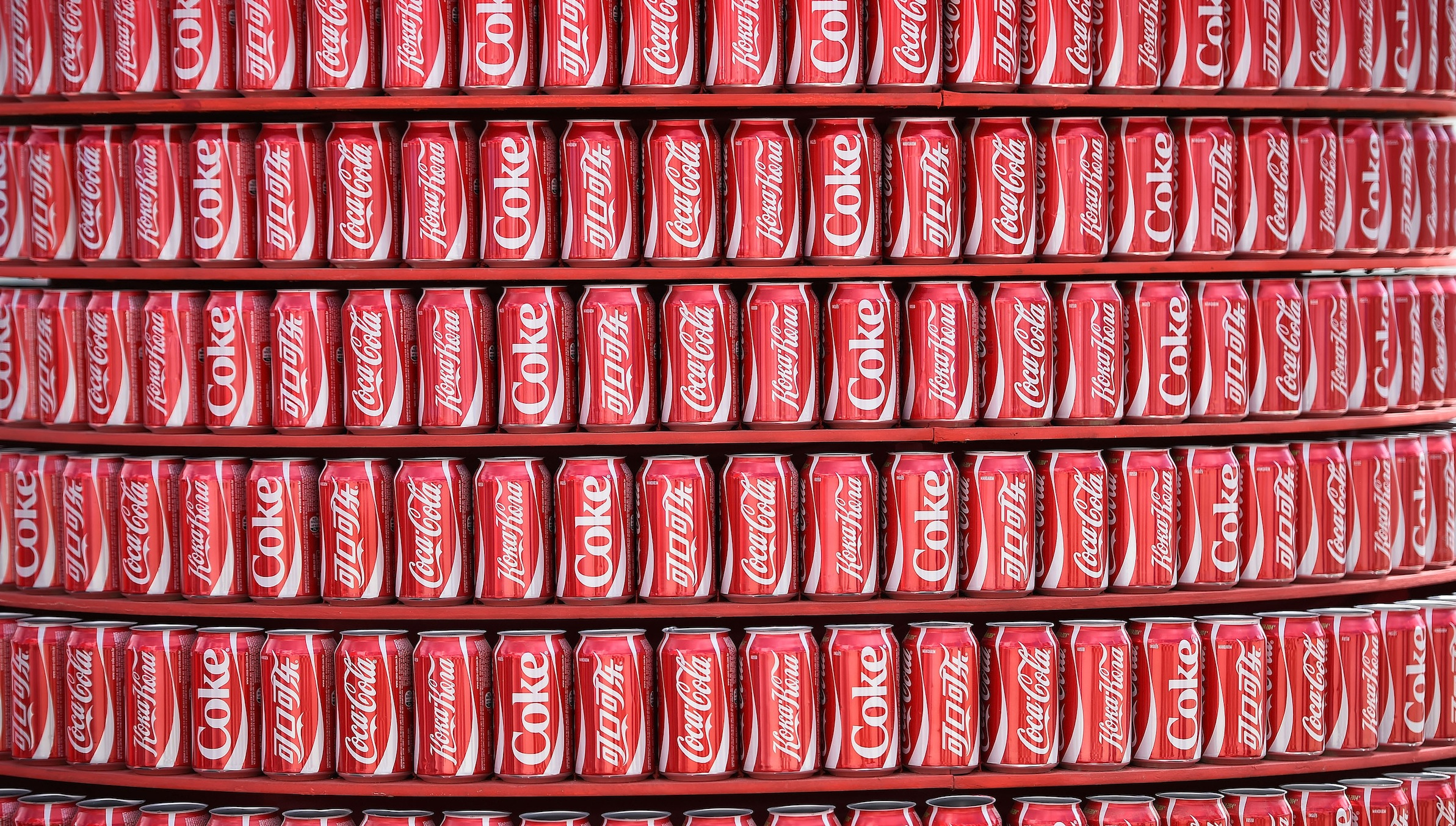 Coca Cola cans are seen at a concession inside the Dunas arena soccer stadium in Natal, June 12 , 2014. Sponsors Adidas , Sony, Visa and Coca-Cola on June 8 called on soccer's rulers to deal thoroughly with allegations of bribery to secure the 2022 World Cup for Qatar, an issue overshadowing this week's kickoff in Brazil.    REUTERS/Dylan Martinez (BRAZIL  - Tags: SOCCER SPORT WORLD CUP BUSINESS)   - RTR3TFZ3