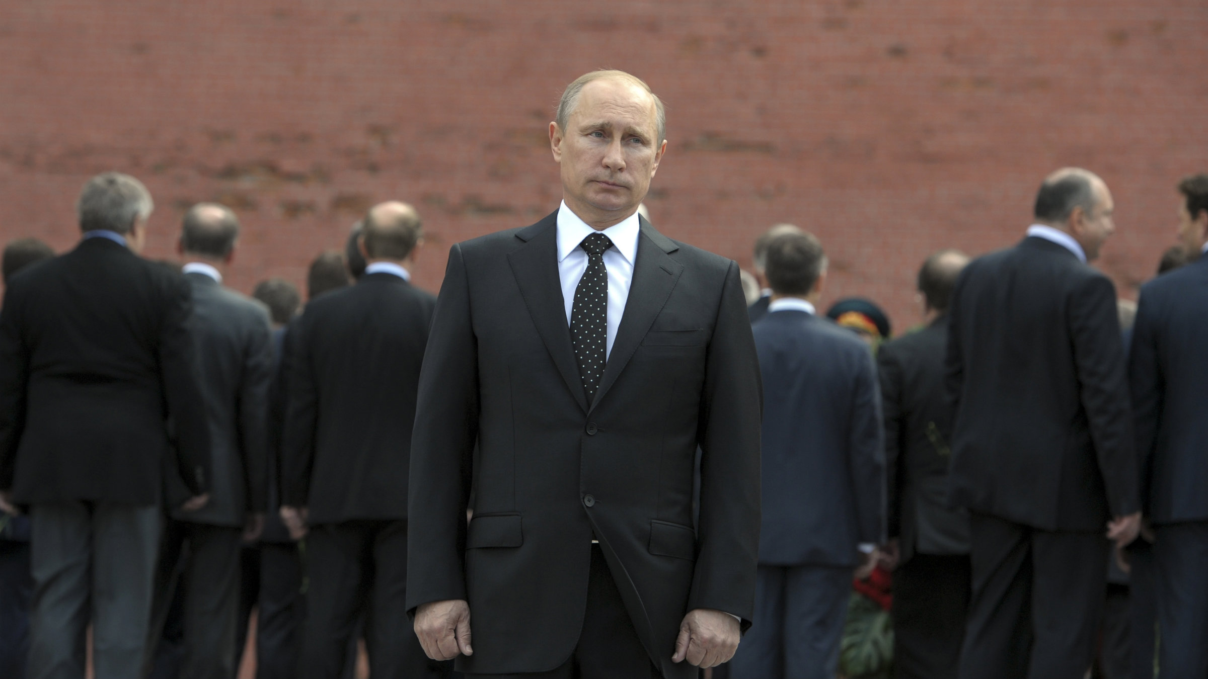 Russia's President Vladimir Putin stands alone at a ceremony outside the Kremlin in Moscow.