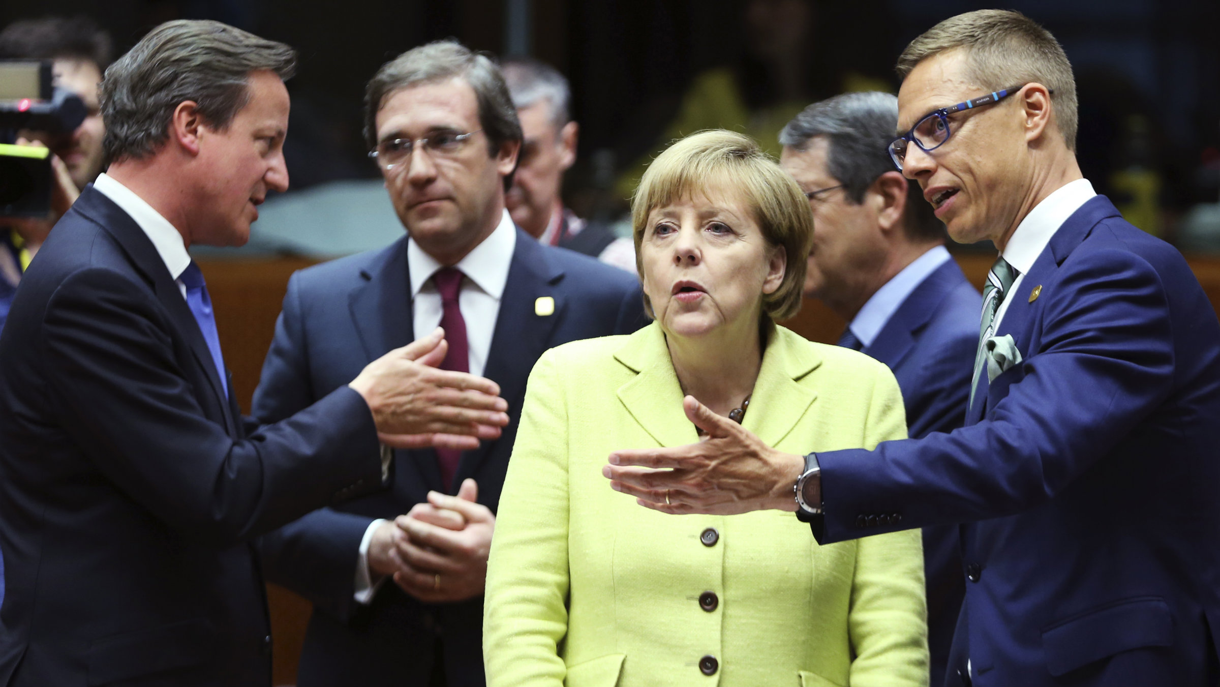 Britain's Prime Minister David Cameron, Portugal's Prime Minister Pedro Passos Coelho, Germany's Chancellor Angela Merkel and Finland's Prime Minister Alexander Stubb attend an European Union leaders summit in Brussels.