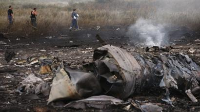 Emergencies Ministry members walk at the site of a Malaysia Airlines plane crash, near the settlement of Grabovo in the Donetsk region of Ukraine.