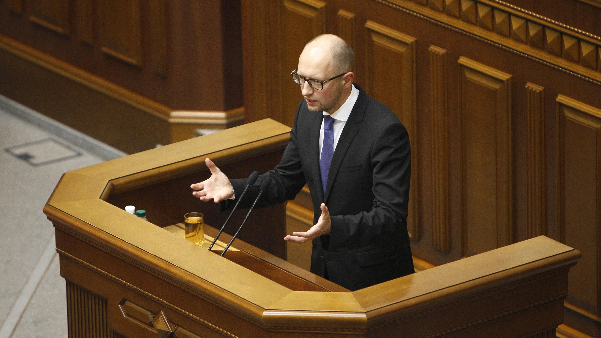 Ukrainian Prime Minister Arseniy Yatsenyuk addresses parliament in Kiev on July 24, 2014, where he tendered his resignation.