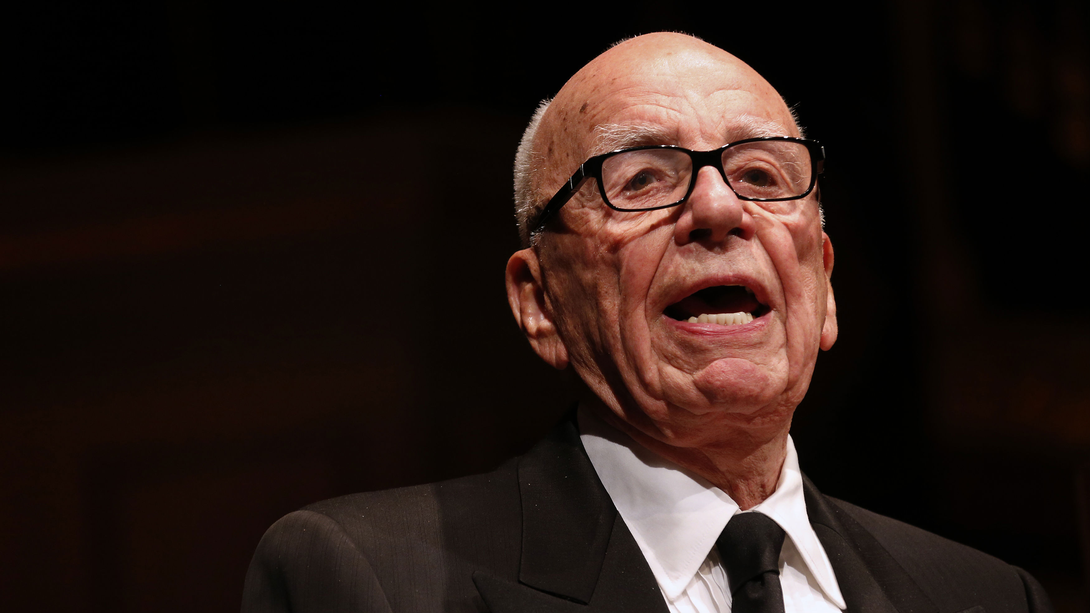 Rupert Murdoch, News Corp. and 21st Century Fox CEO, speaks during the annual Lowy Lecture at the Sydney Town Hall October 31, 2013. Australia should throw open its doors to immigrants to make the country more competitive, media mogul Rupert Murdoch said on Thursday, in contrast to his backing for the new government's tough policy on asylum seekers. Murdoch did not mention during the speech his former British newspaper chief, Rebekah Brooks, and others going on trial in London this week accused of conspiring to illegally access voicemail messages on mobile phones. REUTERS/David Gray