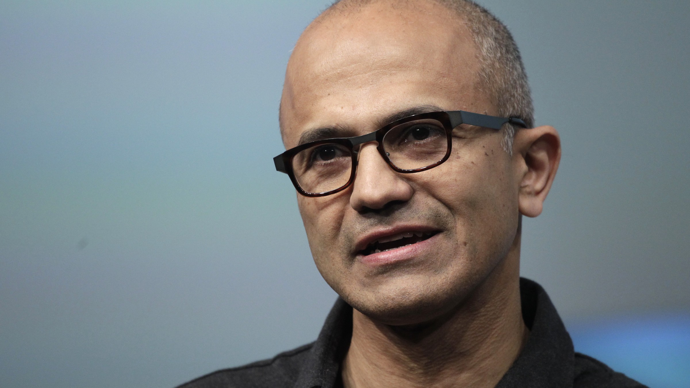 In this May 20, 2014 file photo, Satya Nadella, CEO of Microsoft, talks during the introduction the Surface Pro 3 tablet device at a media preview in New York. Microsoft on Thursday, July 17, 2014 announced it will lay off up to 18,000 workers over the next year. (AP Photo/Mark Lennihan, File)