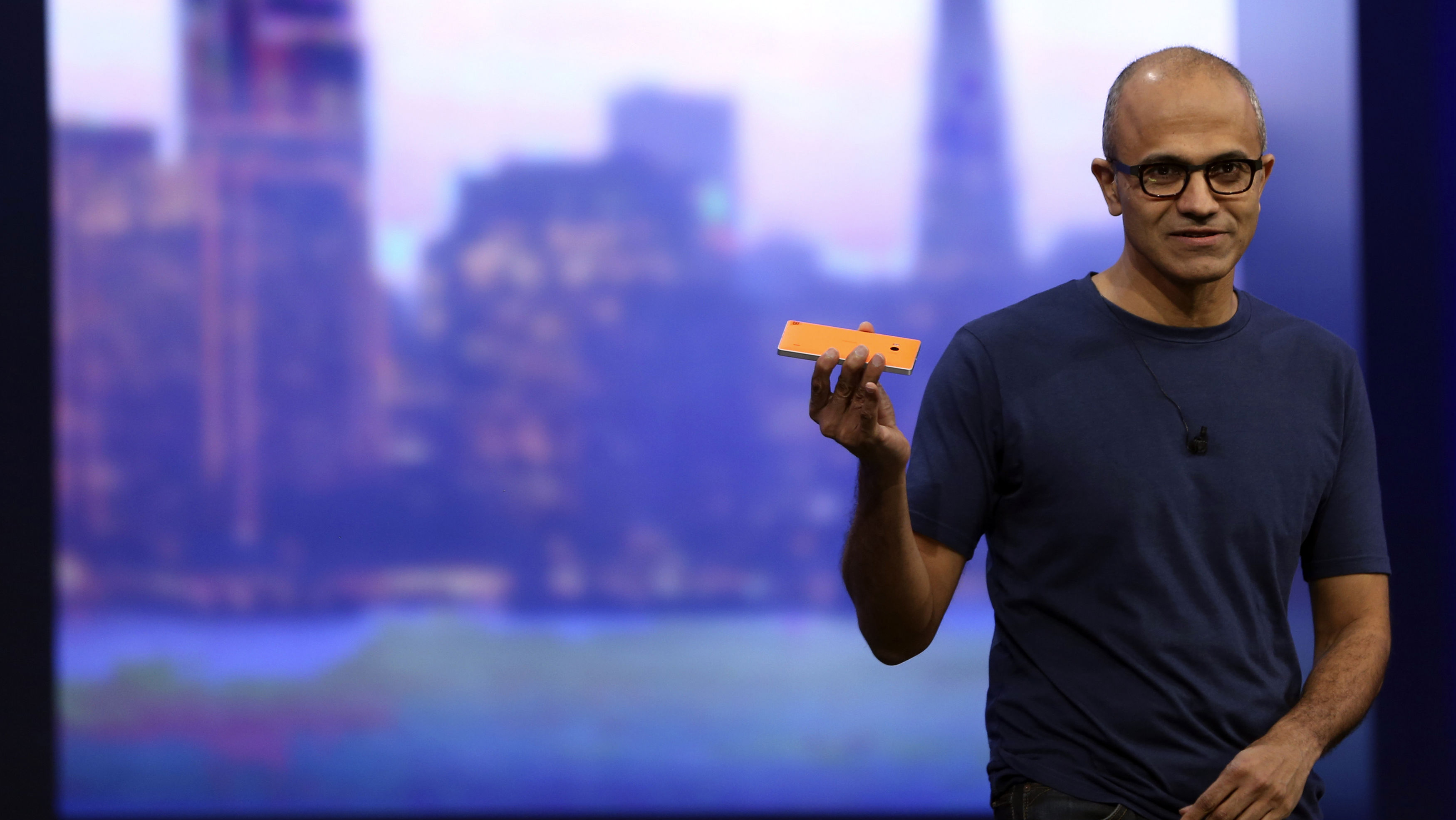 "Microsoft CEO Satya Nadella holds a Nokia Lumia mobile phone featuring Windows 8.1 operating system during his keynote address at the company's ""build"" conference in San Francisco, California April 2, 2014. REUTERS/Robert Galbraith"
