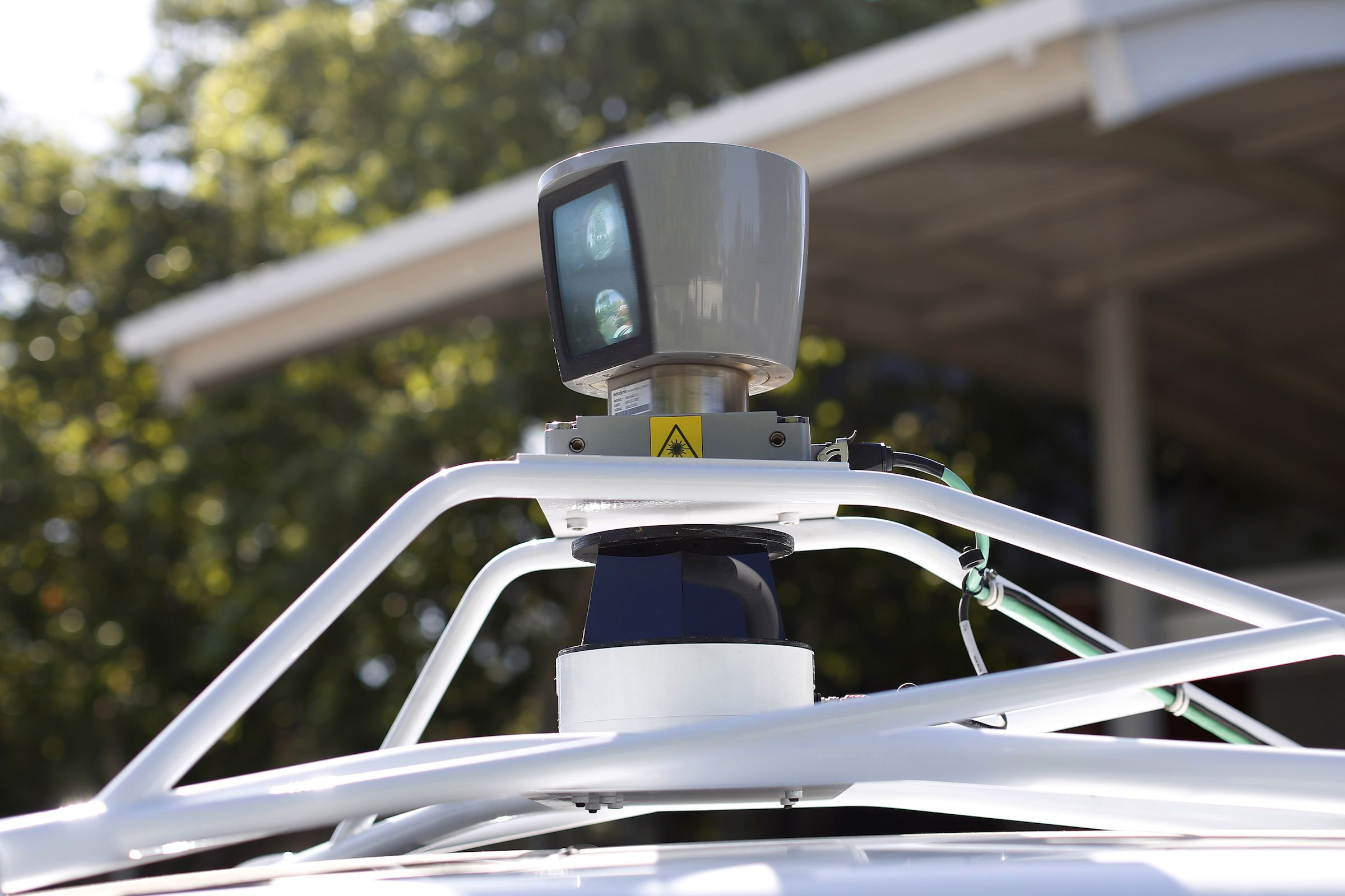 A sensor is seen spinning atop a Google self-driving vehicle before a presentation at the Computer History Museum in Mountain View, California May 13, 2014. REUTERS/Stephen Lam (UNITED STATES - Tags: SCIENCE TECHNOLOGY TRANSPORT) - RTR3OZBV